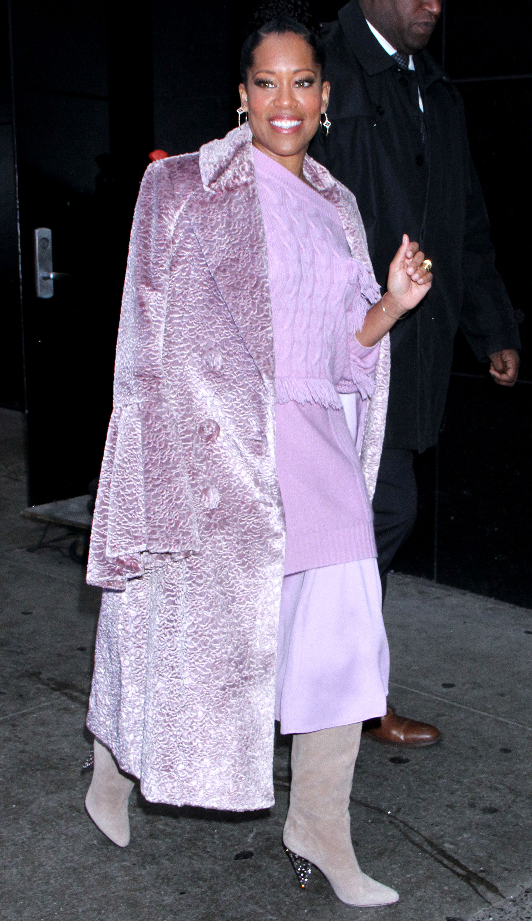 regina-king-purple-lavender-coat - Taking monochrome dressing to new heights, the If Beale Street Could Talk actress mixed various shades of lilac in NYC on Tuesday, December 13, but it's her textured velvet coat that stole the show.