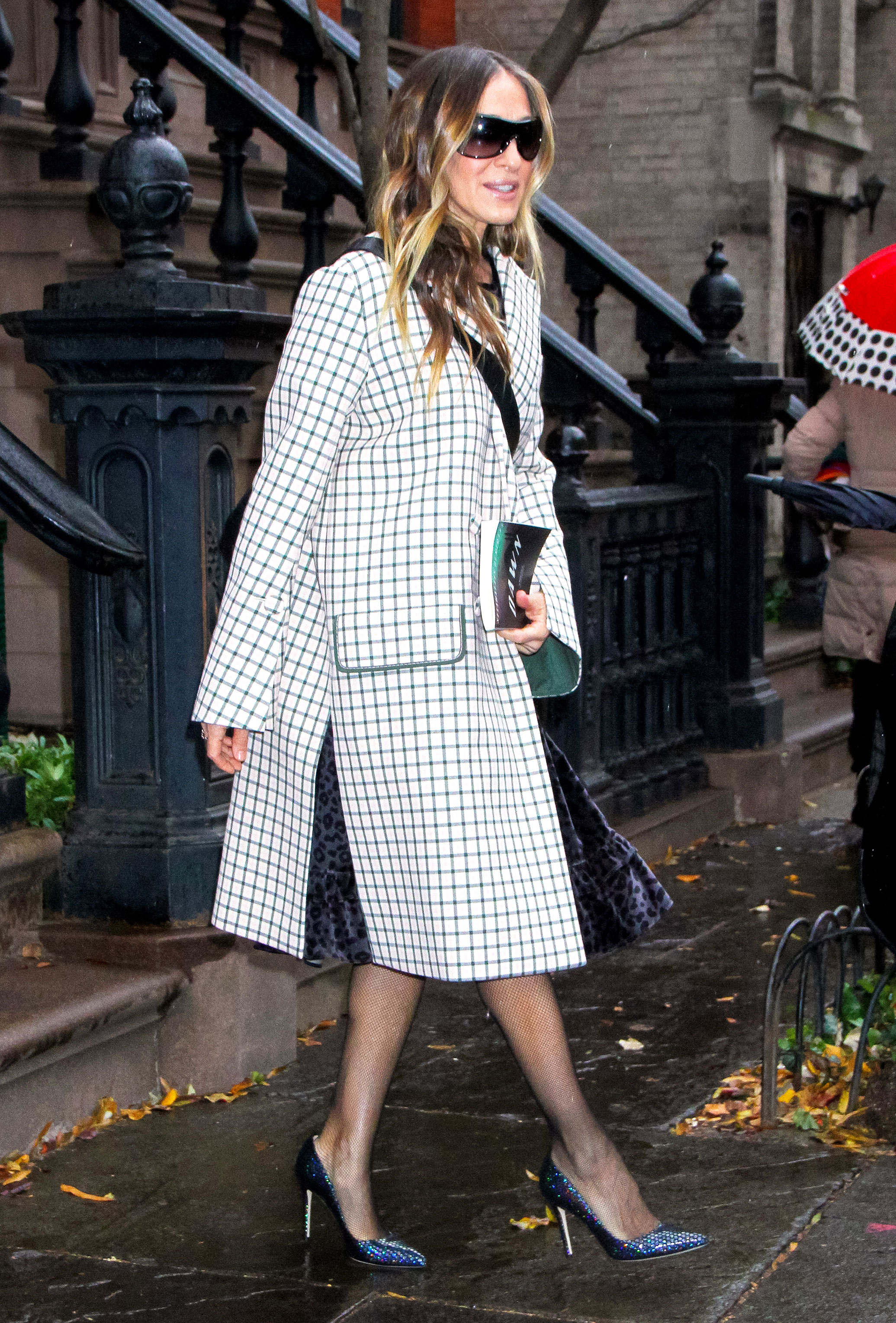 sarah-jessica-parker-checkered-coat - On her way to the Muse Awards in NYC on Thursday, December 13, the actress topped off her velvet black Batsheva frock and sparkly pumps with a grey and white check coat that Carrie Bradshaw would approve of.