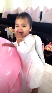 khloe kardashian shares videos of true wearing gold angel wings, playing with Christmas toys