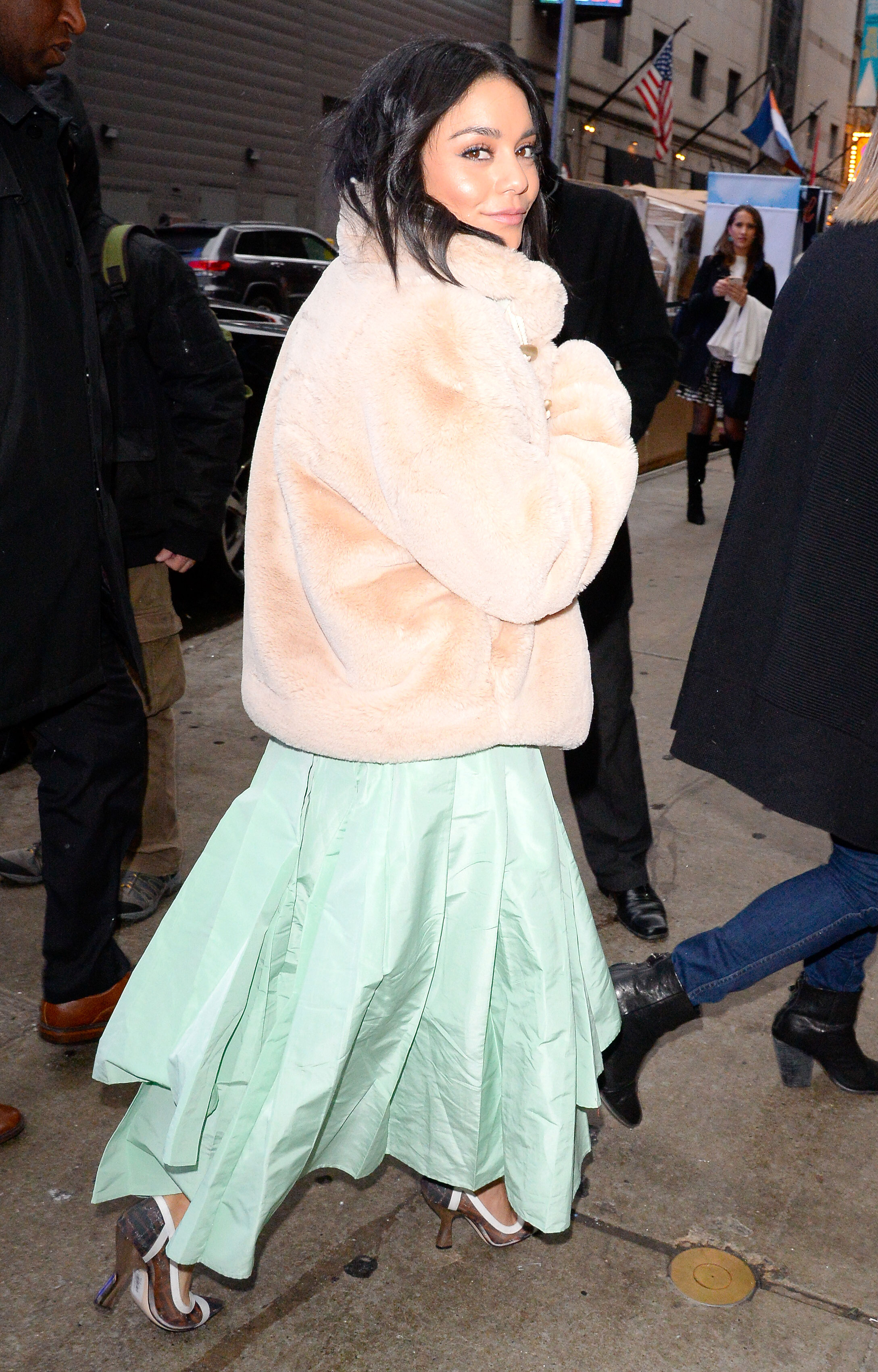 vanessa-hudgens-tan-coat - Sure, we've still got a ways to go until the first signs of spring, but we'll be filing this Golden Goose shearling look the Second Act star rocked in NYC on Thursday, December 13, away as the perfect way to rock our pastel dresses when the seasons start to change.