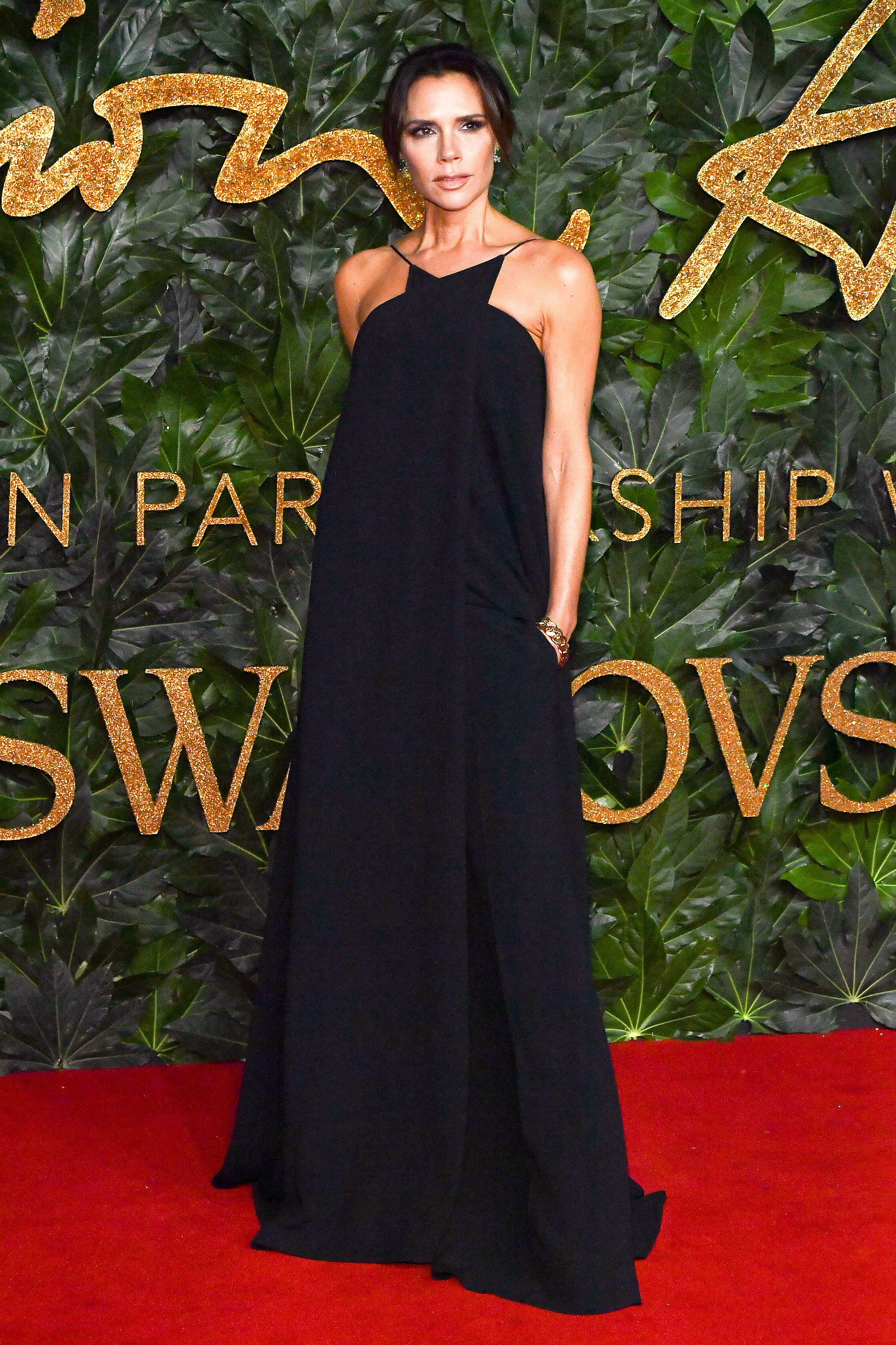 victoria-beckham - The former Spice Girl sported one of her own strappy black designs.