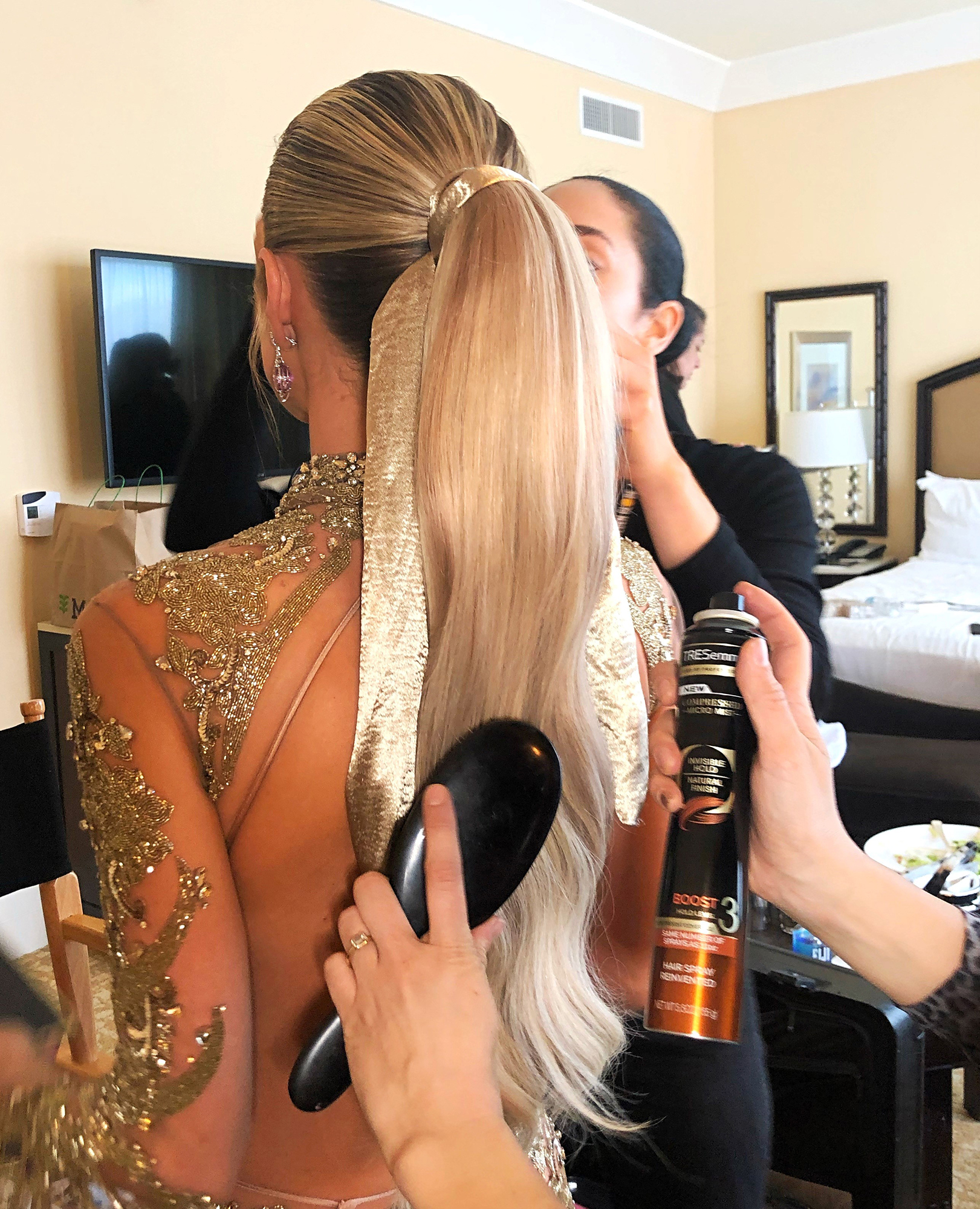Kristin-Cavallari's-Golden-Globes-Beauty-Prep - To ensure a super sleek effect at the crown, the hair pro prepped the TV personality's strands with TRESemmé Thermal Creations Blow Dry Balm before blowdrying with her ghd Air Hair Dryer and a smoothing brush. Working with Cavallari's natural hair, Marjan created two ponytails stacked on top of each other (another #ProTip of hers) and kept everything in place with the TRESemmé TRES Two Extra Hold Mousse at the roots.