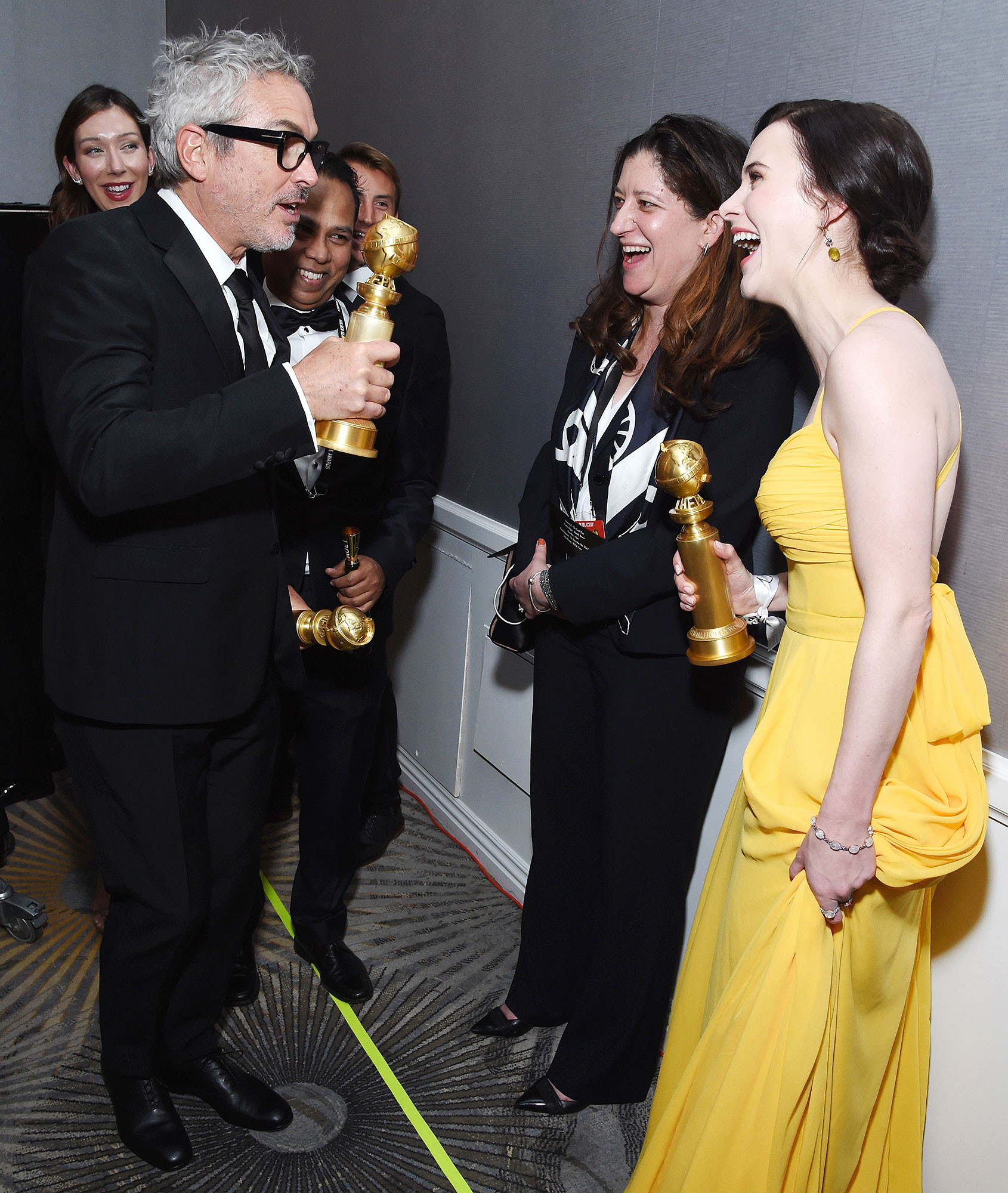 Inside Golden Globes 2019 Alfonso Cuaron Rachel Brosnahan - Alfonso Cuarón and Rachel Brosnahan bumped into each other backstage and held up their respective awards for best director ( Roma ) and best actress in a TV musical or comedy ( The Marvelous Mrs. Maisel ).