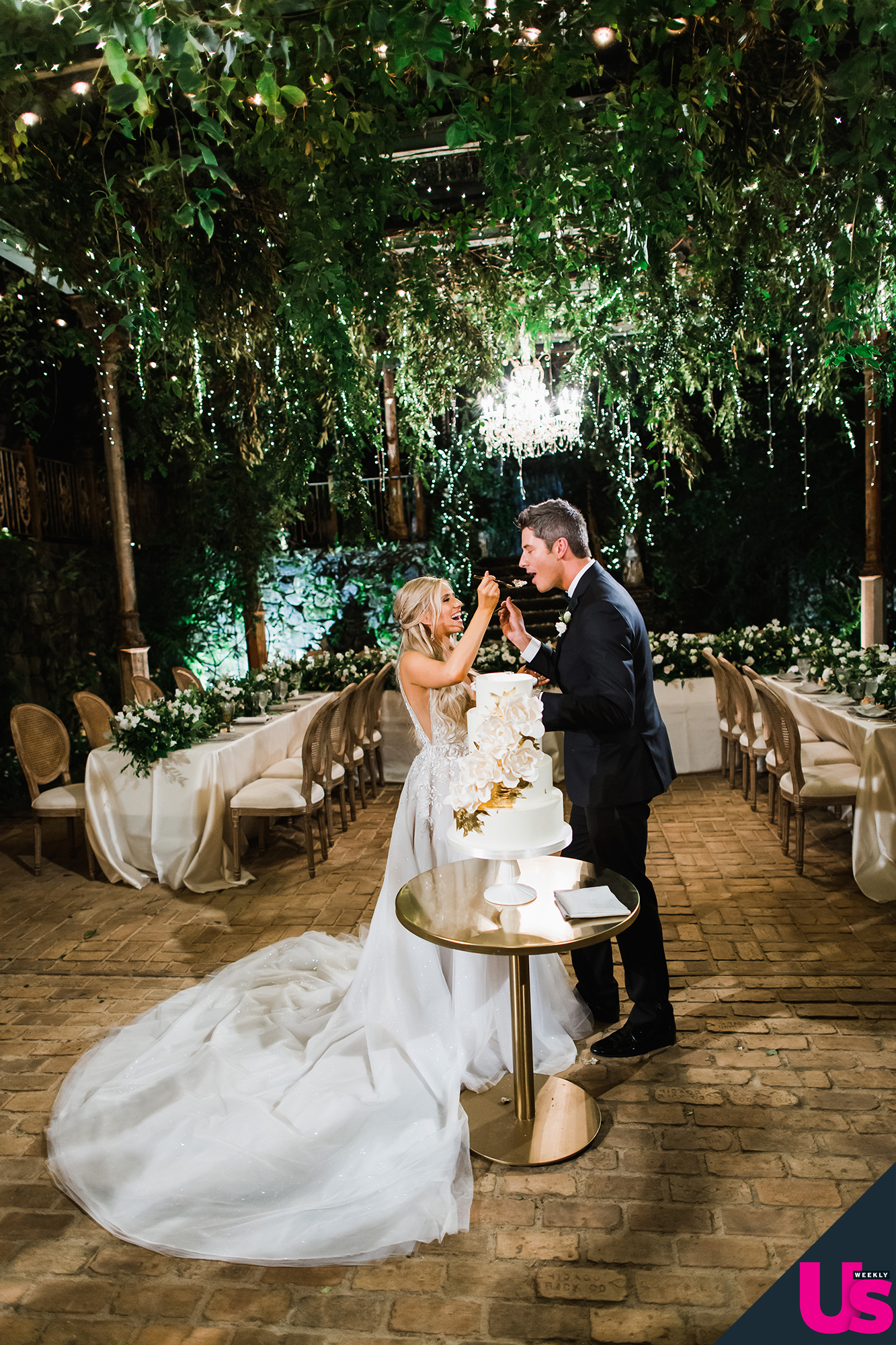 """Arie-Luyendyk-Jr. -and-Lauren-Burnham-Wedding - The wedding planner also noted that Burnham was crazy about the """"twinkle lights and hanging greens"""" during the big day."""