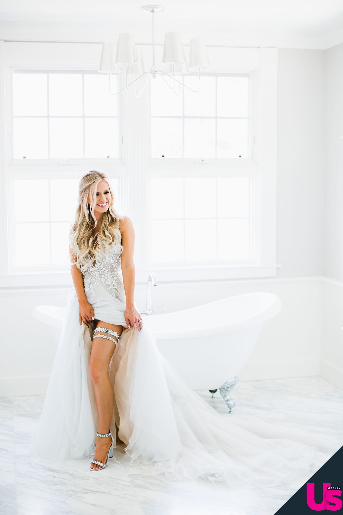 Arie-Luyendyk-Jr. -and-Lauren-Burnham-Wedding - For her something borrowed and something blue, the Virginia Beach native wore a custom La Gartier wedding garter, with a piece of one of her now-husband's racing suits cut into a blue heart.