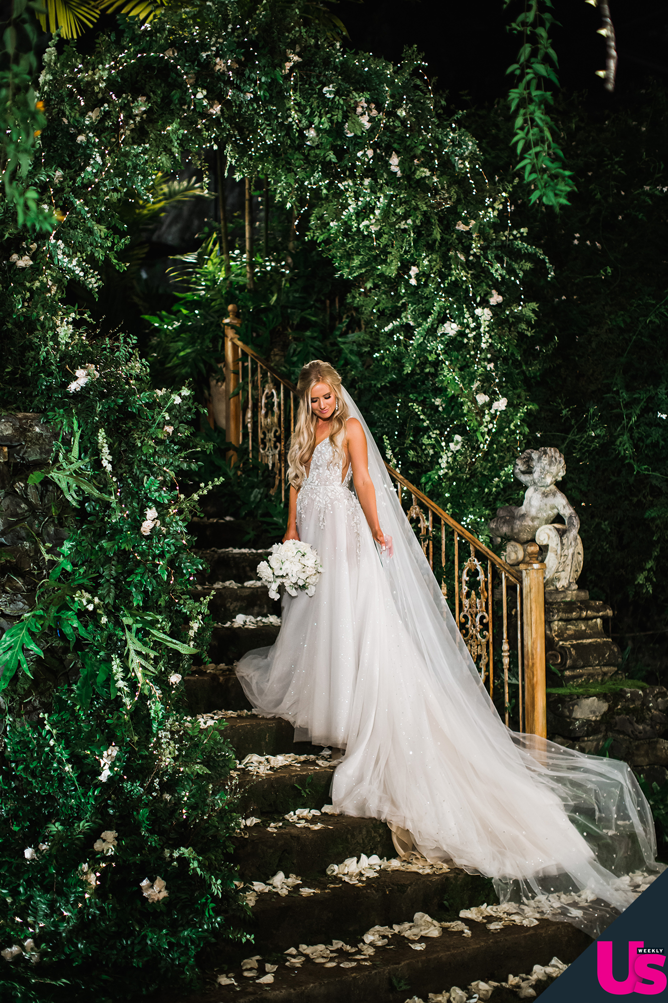"""Arie-Luyendyk-Jr. -and-Lauren-Burnham-Wedding - The floral arrangements were created by Mandy Grace Designs and """"Lauren's bouquet feature a stunning large all-white collection of ranunculus and specialty garden roses wrapped with ivory silk ribbon,"""" Hosaki told Us ."""