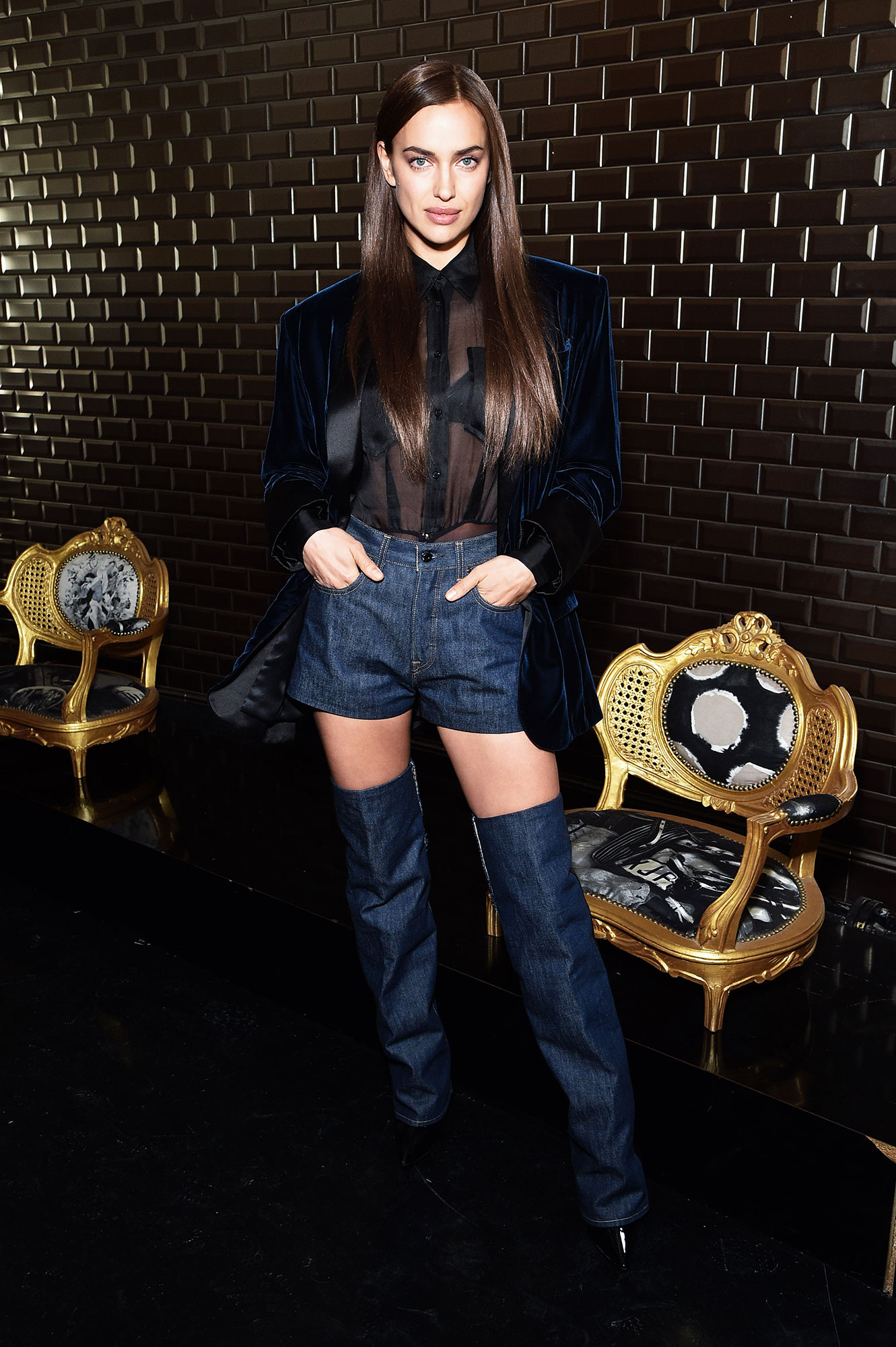 Irina Shayk - Showing Us how to wear shorts in the winter, Bradley Cooper's better half rocked denim shorts with matching thigh-high boots and a sheer shirt at the Jean Paul Gaultier show on Wednesday, January 23.