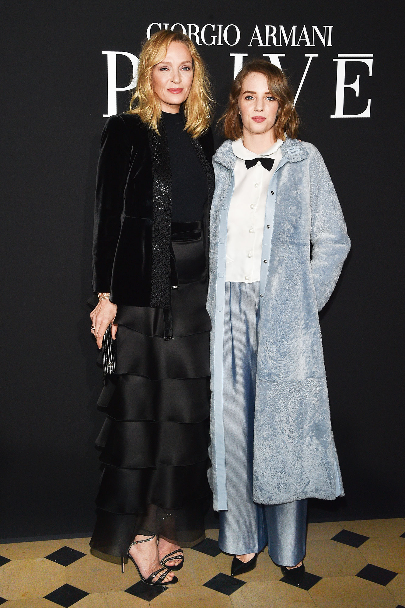 Uma Thurman and her daughter Maya Hawke - Like mother, like daughter! The duo made the front row a family affair at Giorgio Armani Prive on Tuesday, January 22, in stylish separates.