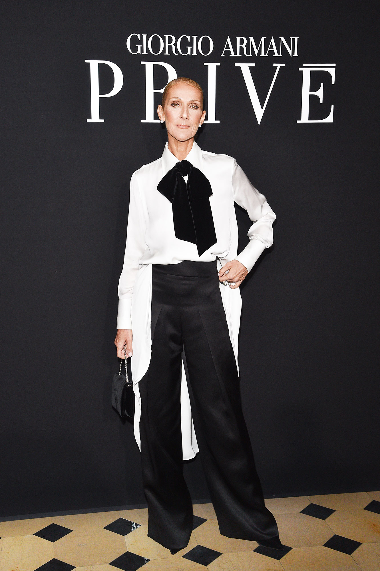 Celine Dion - Black and white is always a good idea, as the songstress proved at the Giorgio Armani Prive show on Tuesday, January 22, in her bow-adorned suit.