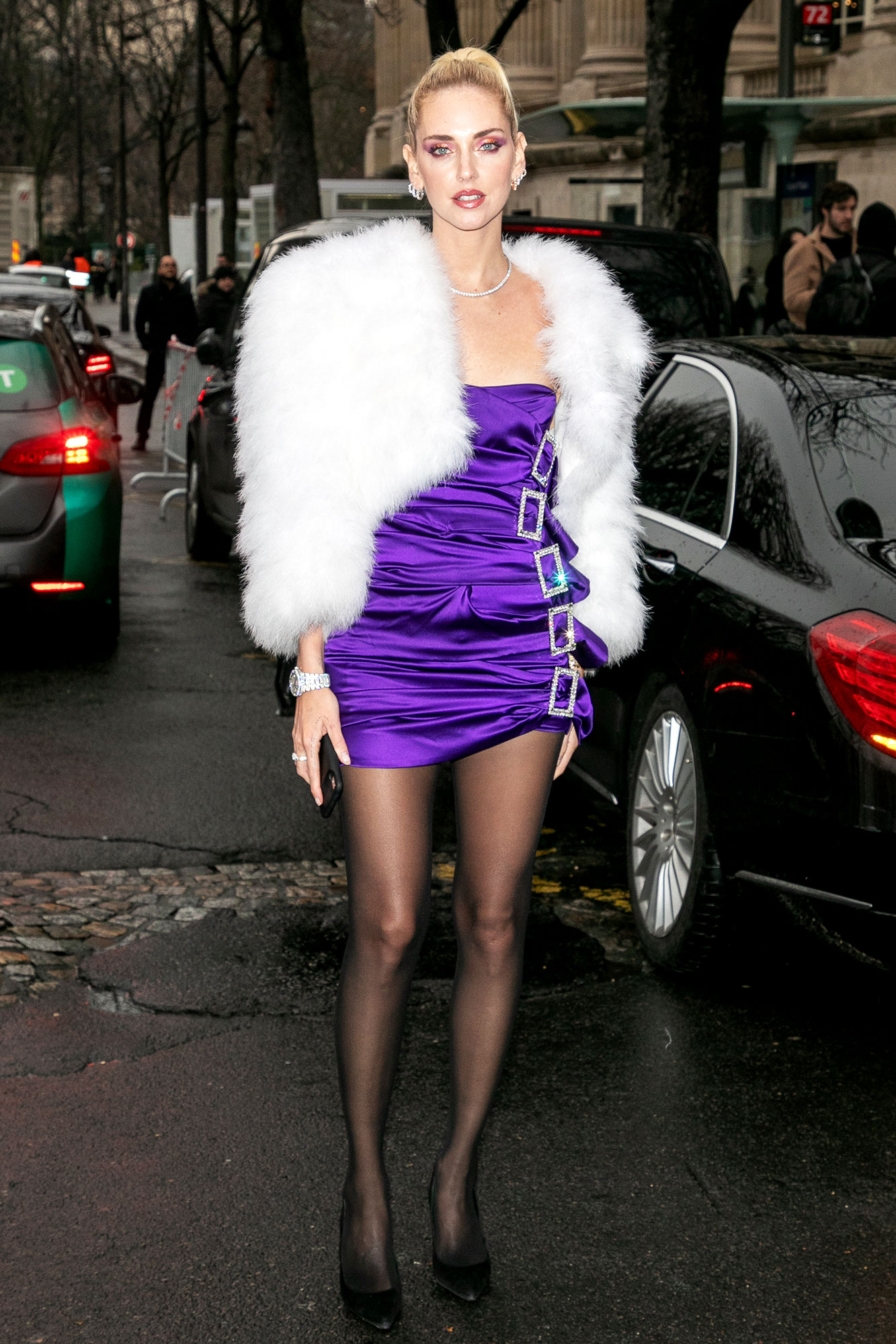 Chiara Ferragni - Keeping things super short and sweet, the blogger showed some leg in a purple ruched mini and furry white shrug on Tuesday, January 22.