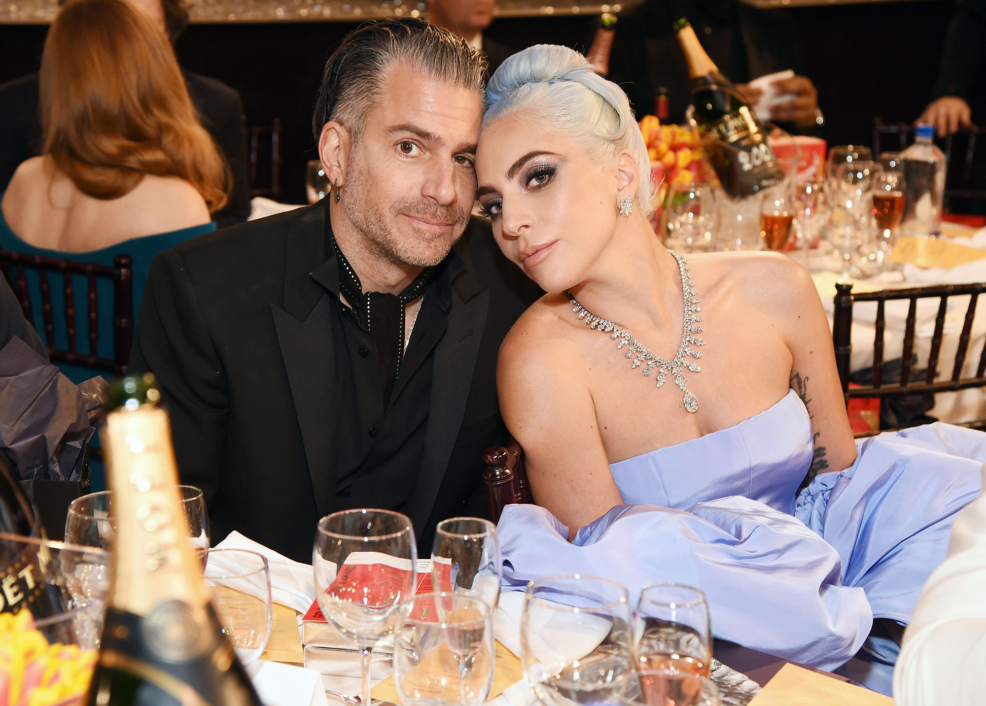 Inside Golden Globes 2019 Christian Carino Lady Gaga - Lady Gaga cozied up to her fiancé, Christian Carino , at their table in the audience.