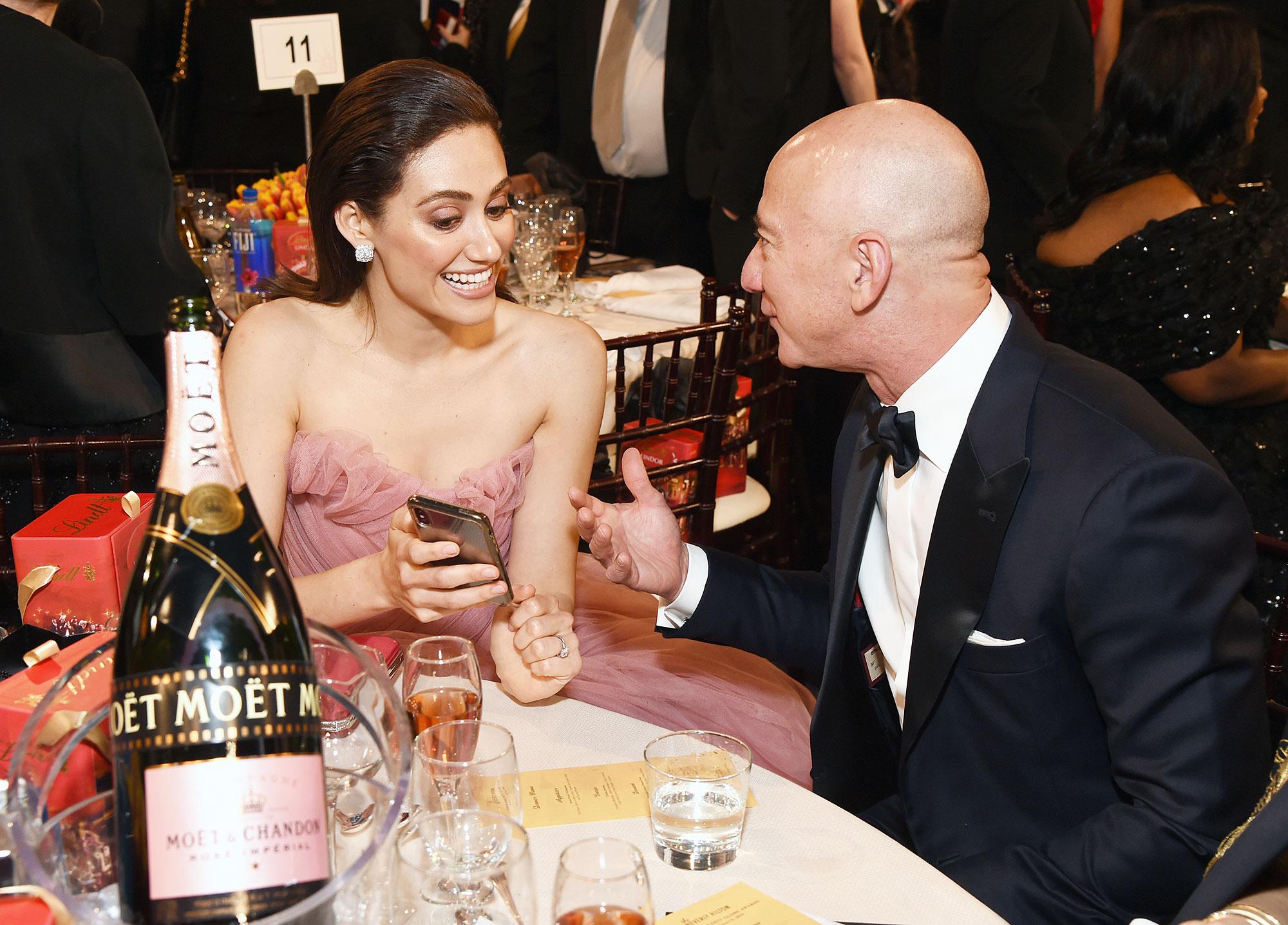 Inside Golden Globes 2019 Emmy Rossum Jeff Bezos - Emmy Rossum showed Amazon founder Jeff Bezos something on her phone during their conversation.