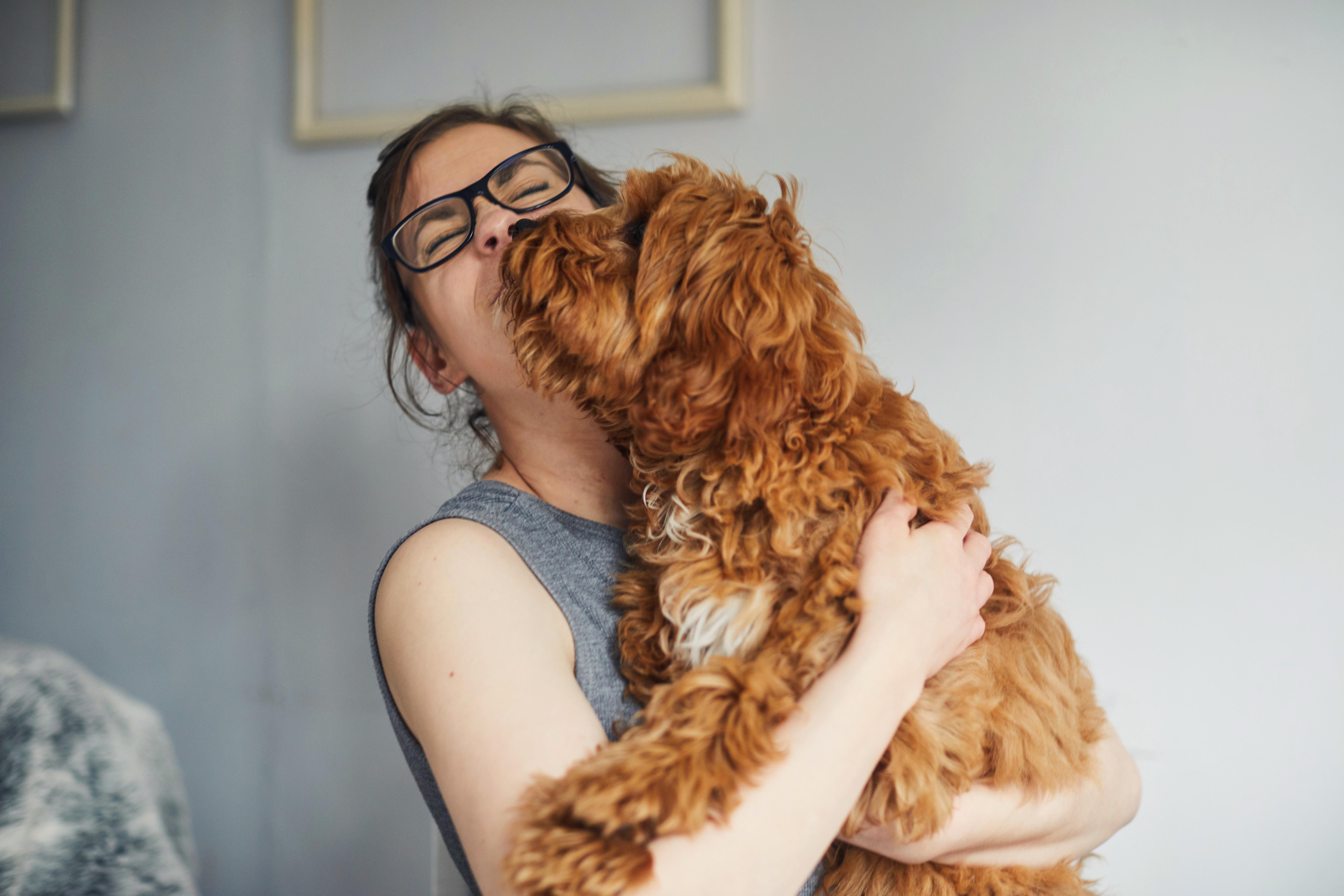 woman holding pet dog