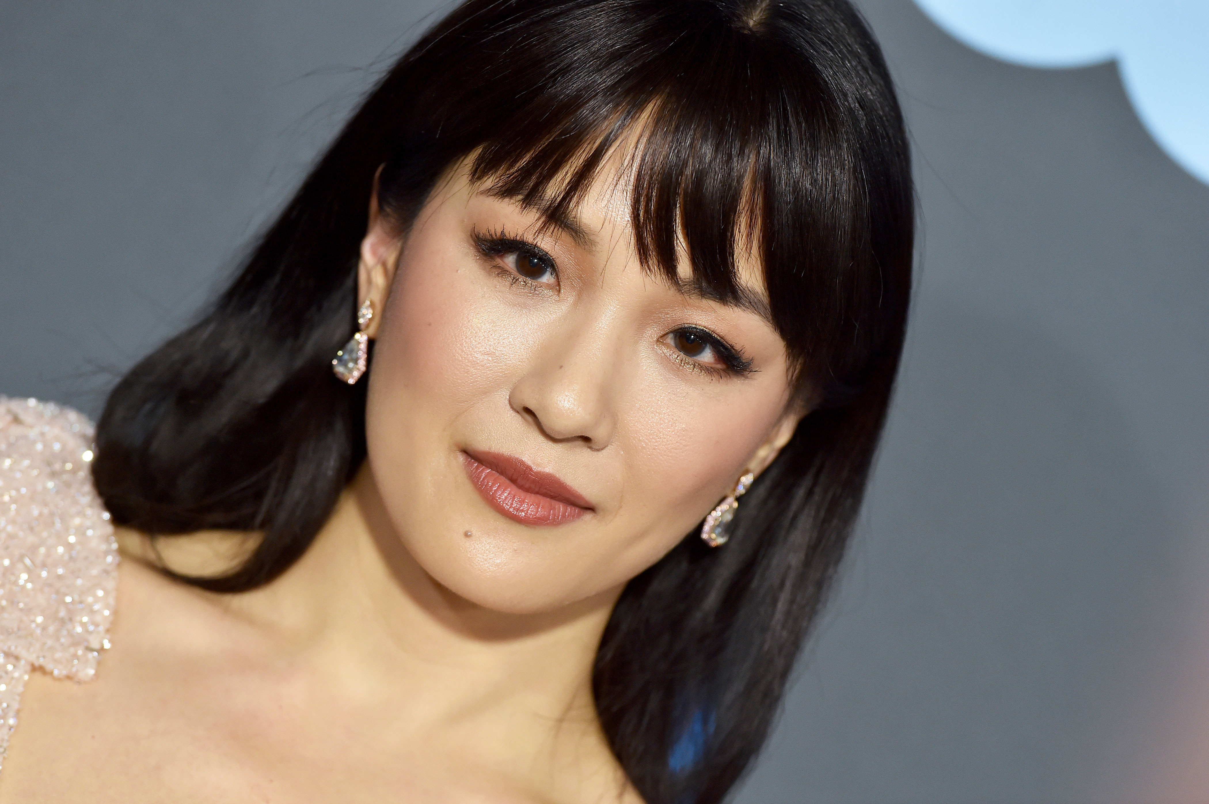 Constance Wu Critics' Choice Awards 2019 - With freshly shorn bangs by Derek Yuen using toos by ghd and glimmering gilded lids by makeup artist Molly Greenwald using Pat McGrath Labs.