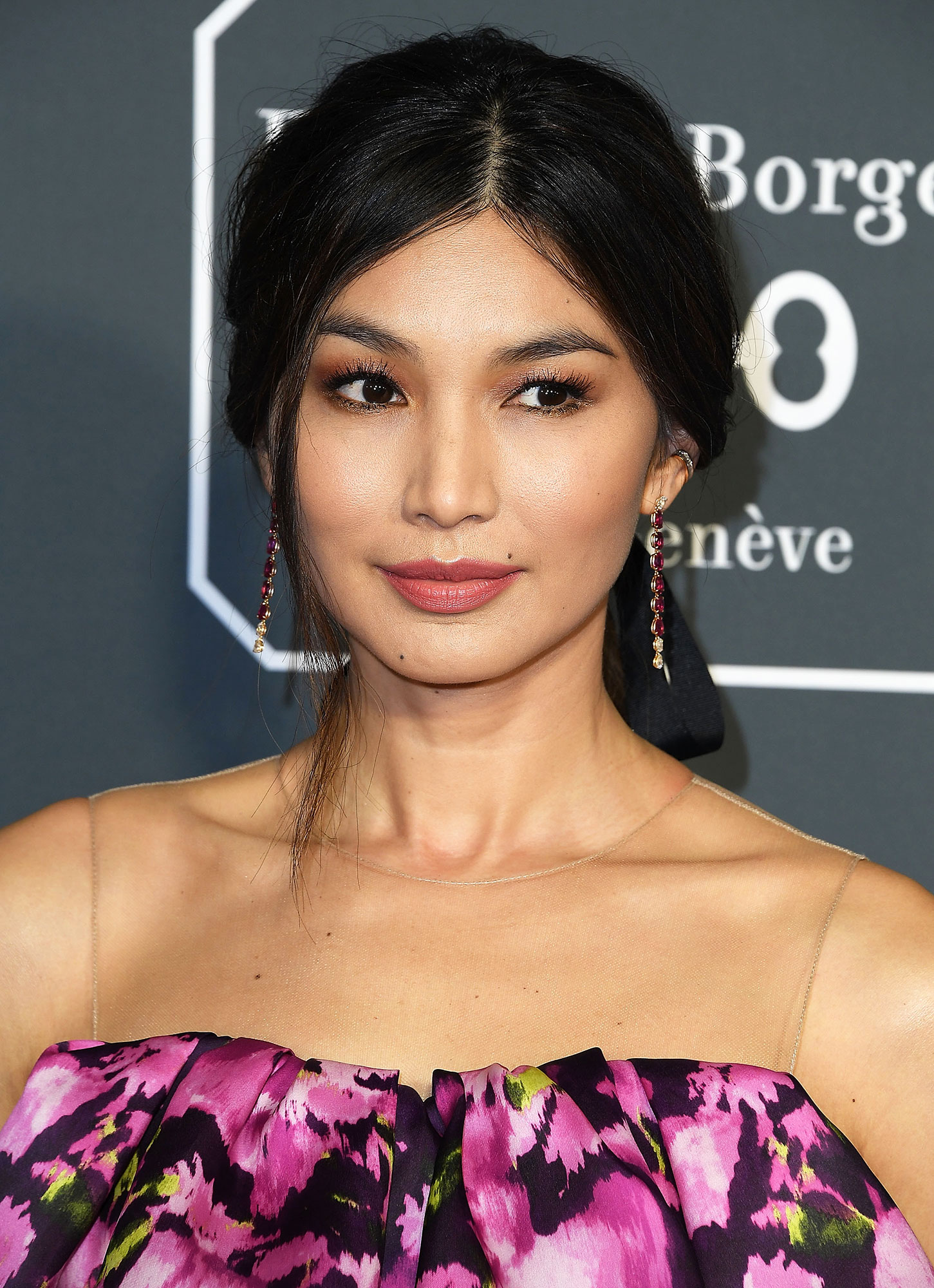 Gemma Chan Critics' Choice Awards 2019 - With a sexy-chic center parted low ponytail by stylist Clarissa Rubenstien using Dove products and candy pink lips by makeup pro Monika Blunder using Pat McGrath Labs.