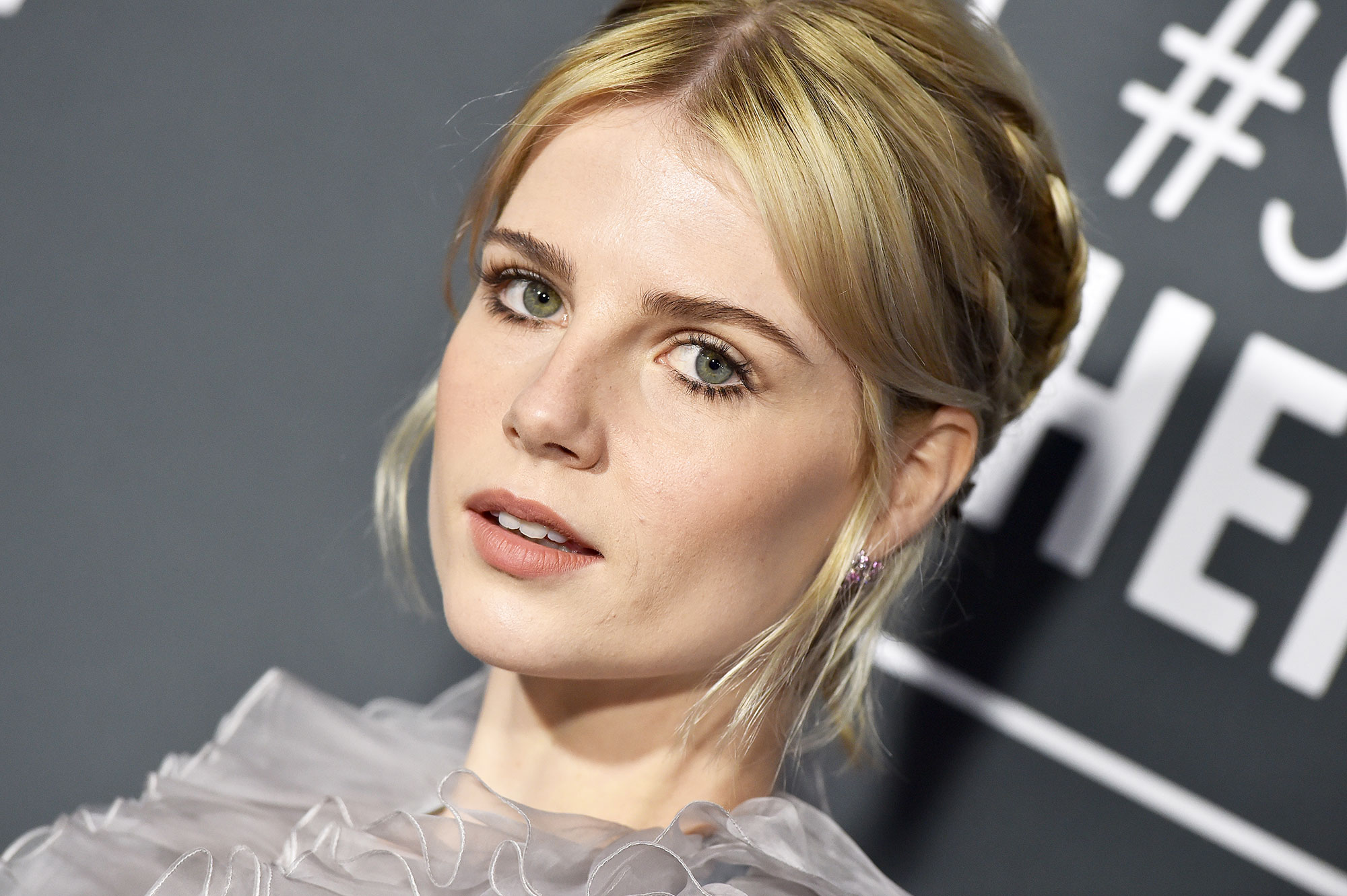 Lucy Boynton Critics' Choice Awards 2019 - With a center-parted updo with mini braids by mane master Jenny Cho and Twiggy-inspired makeup by Kate Lee using Chanel.