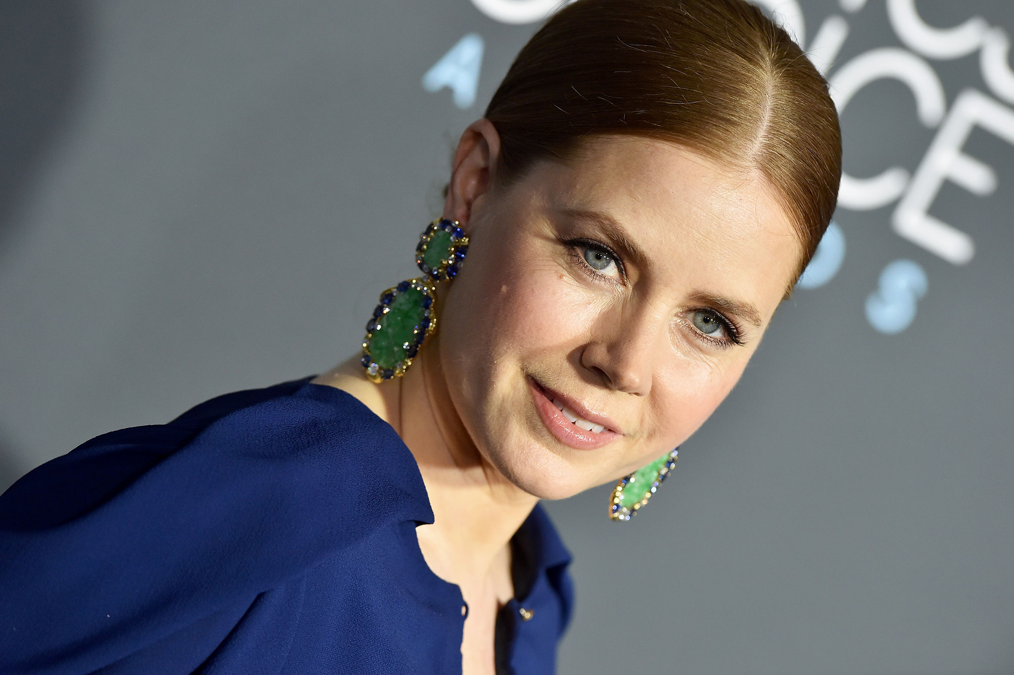 Amy Adams Critics' Choice Awards 2019 - With a sleek center-parted bun by hairstylist John D. using TRESemme products and peachy nude makeup by Stephen Solitto using Beautycounter.