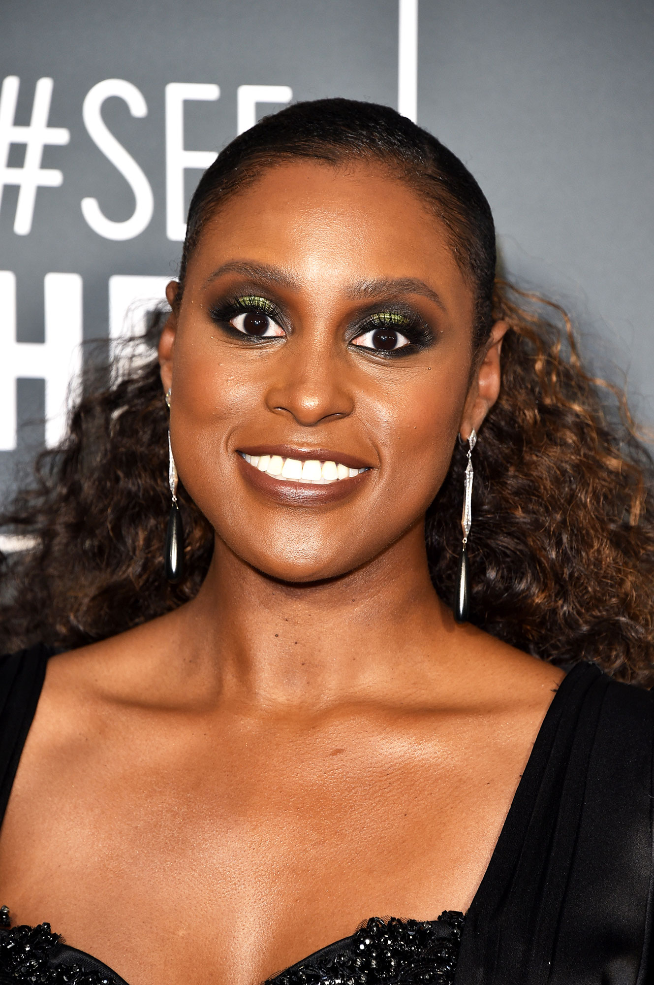 Issa Rae Critics' Choice Awards 2019 - With pulled back flowing curls and gunmetal smokey eyes.