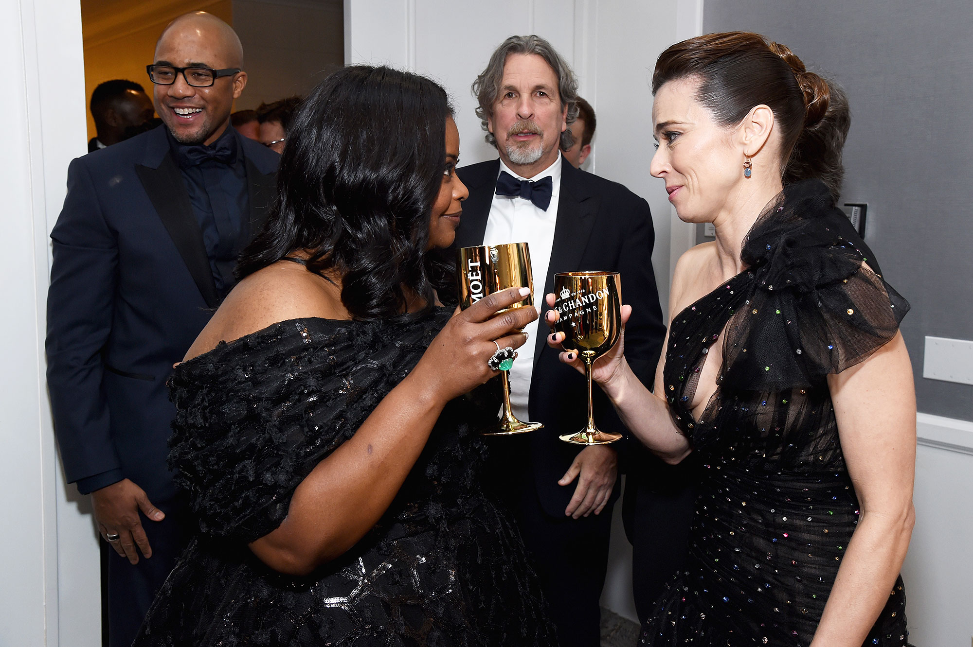 Inside Golden Globes 2019 Octavia Spencer Linda Cardellini - Octavia Spencer and Linda Cardellini clinked Moët and Chandon champagne glasses backstage.