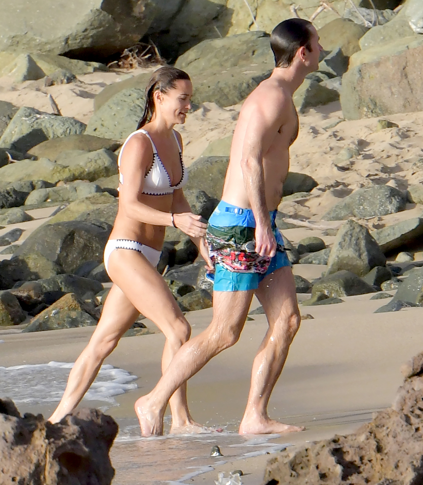 Pippa-Middleton-white-bikini-st-barts-James-Matthews - Middleton — with a wide smile — reached for Matthews' waist as they strolled on the sand.