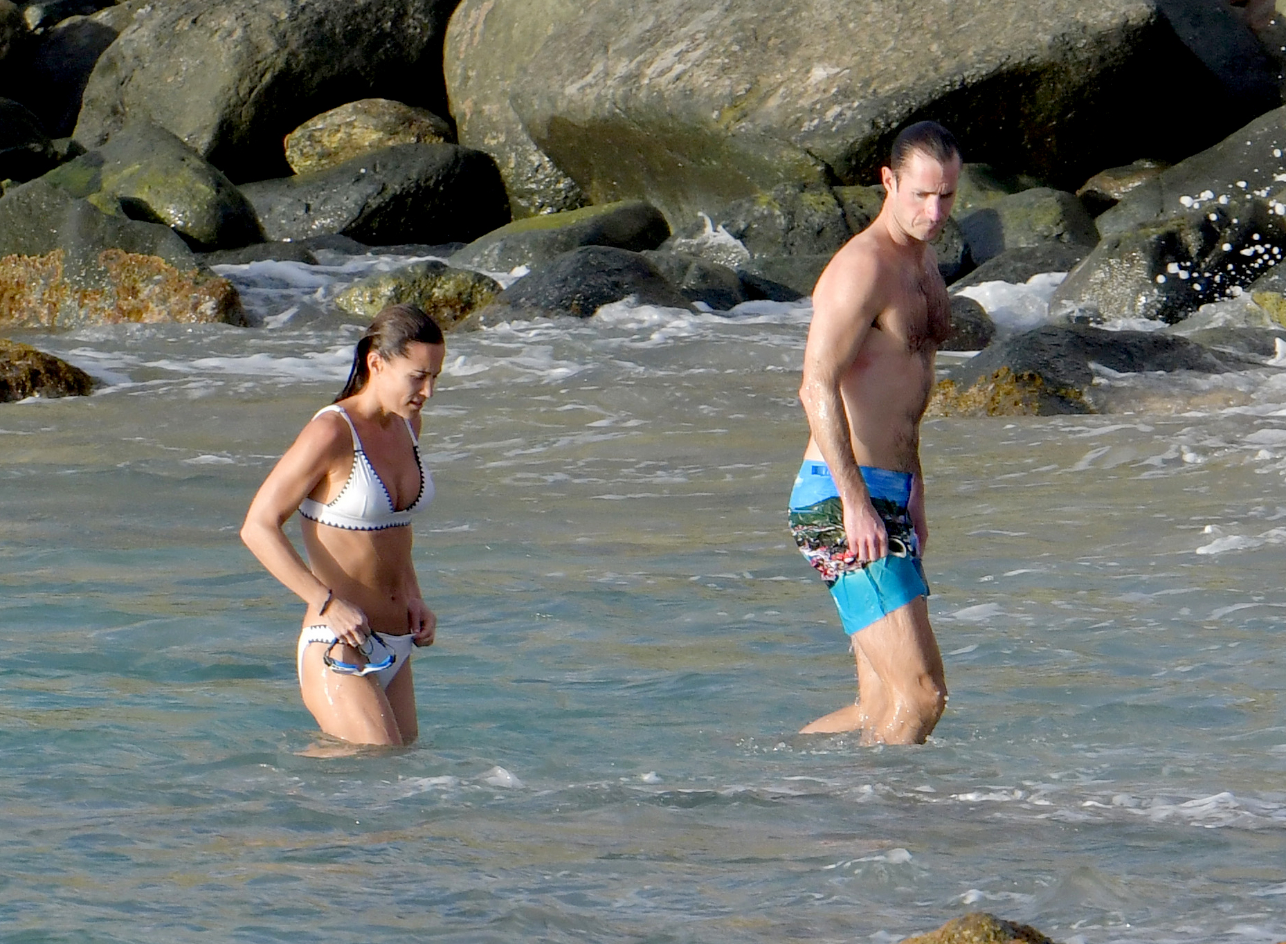 Pippa-Middleton-white-bikini-st-barts-James-Matthews - Middleton wasn't the only one sporting a toned physique for the outing. The race car driver wore printed blue swim trunks and was all muscle as he stepped out of the water alongside his wife.