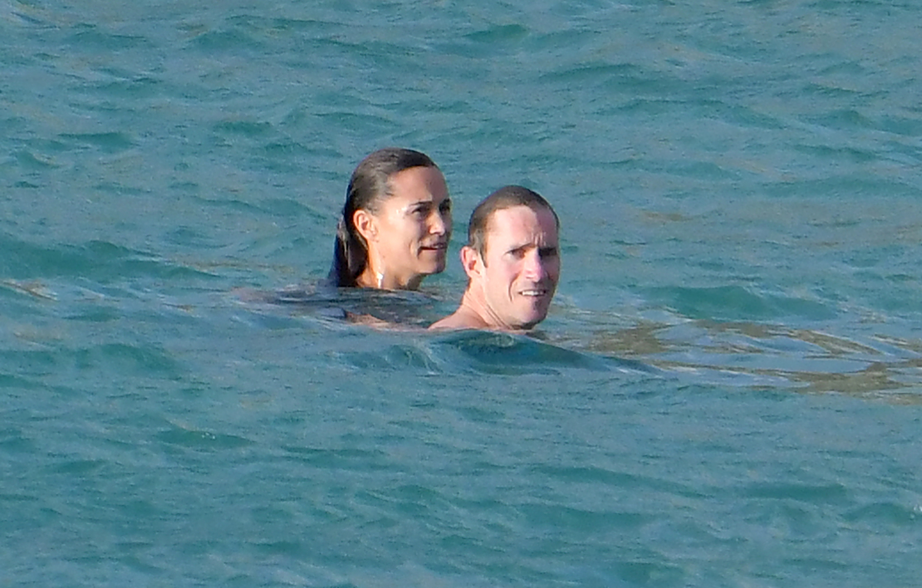 Pippa-Middleton-white-bikini-st-barts-James-Matthews - The couple were neck-deep in the water as they enjoyed some quality time sans their 2-month-old son. Us Weekly confirmed in October that the two had welcomed their first child.
