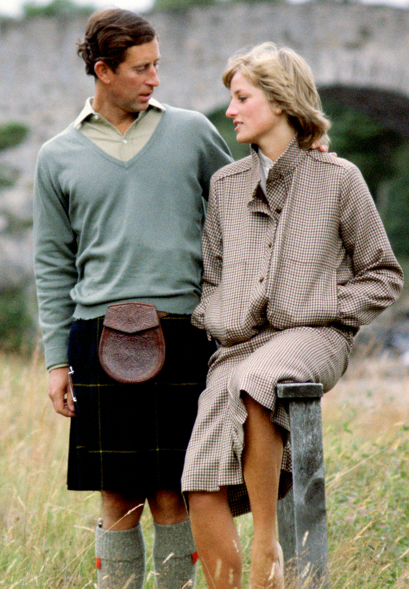 Prince-Charles-princess-diana-feud - BALMORAL, UNITED KINGDOM – AUGUST 19: Prince Charles, Prince of Wales with his arm around Princess Diana, Princess of Wales as they sit on a style during their honeymoon at Balmoral in Scotland. The Princess is wearing a suit designed by Bill Pashley.