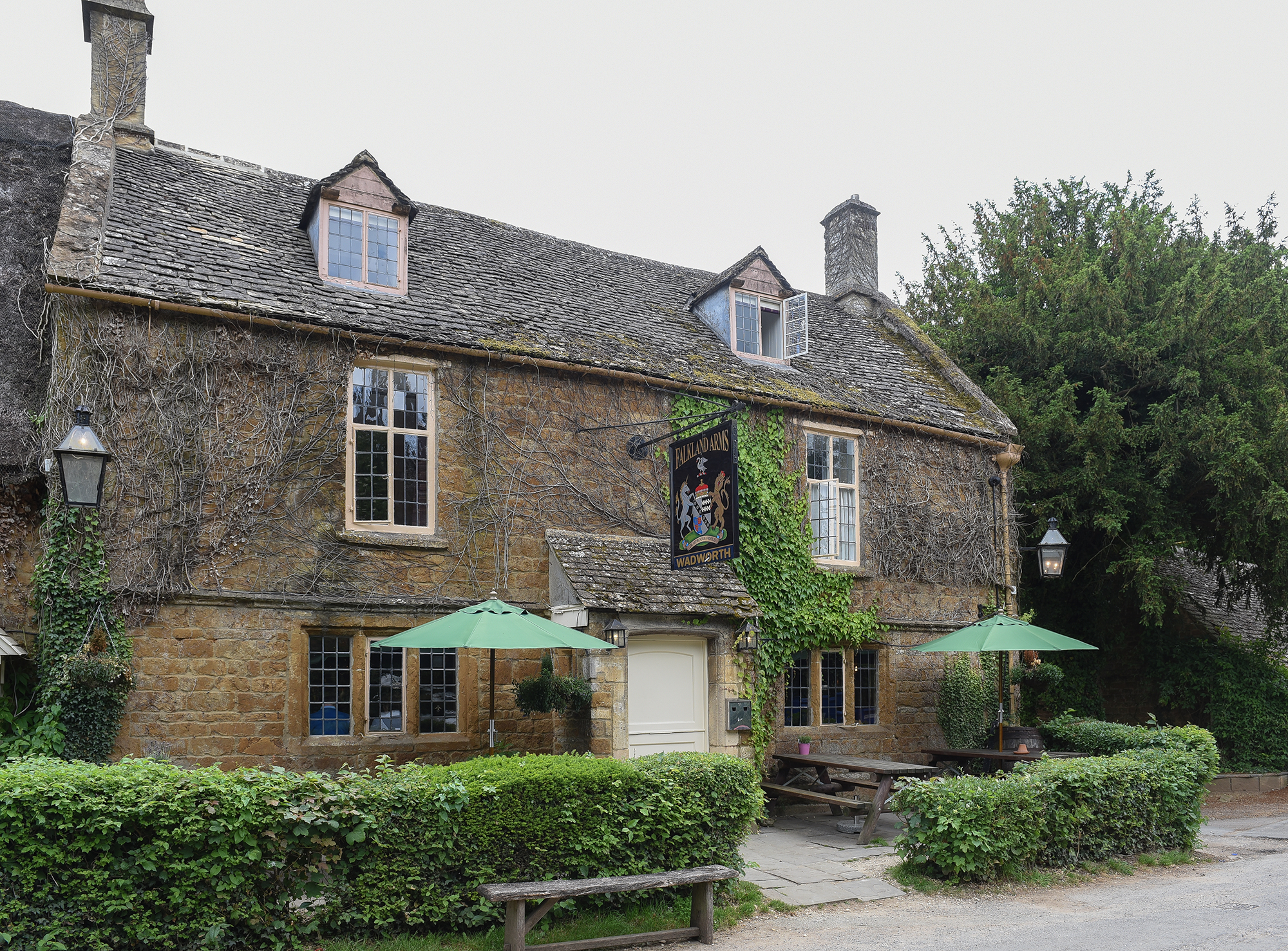 Prince-Harry-and-Duchess-Meghan's-Country-Retreat - Meghan and Harry's Oxfordshire home is close to one of the Suits alum's favorite places, Soho Farmhouse , and is also conveniently located a short walk from the former military pilot's pub, The Falkland Arms (pictured here). The 16-century building features a thatched roof, flagstone floors and oak beams, while the pub's menu includes a selection of beers and bites including a shared starter of Cotswold rare breed plate of cured pig and salami with olives, cornichons, smoked whipped lardo and rustic bread.