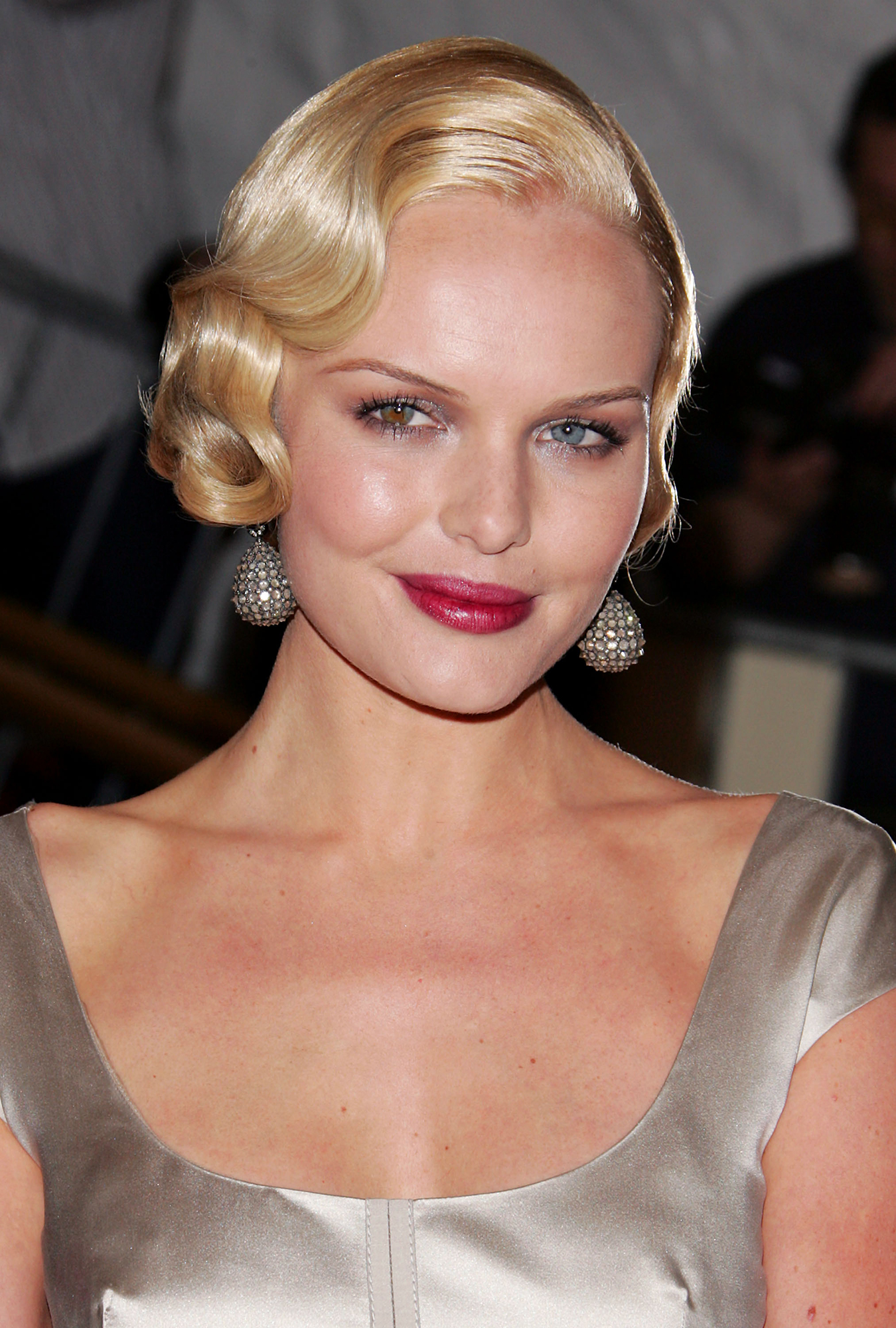 "See Birthday Girl Kate Bosworth's Best Beauty Moments - The Win a Date With Tad Hamilton star harkened back to Hollywood's heyday with her sculptural curls, wine-stained lips and blingy earrings at the 2007 ""Poiret: King of Fashion""-themed Met Gala."