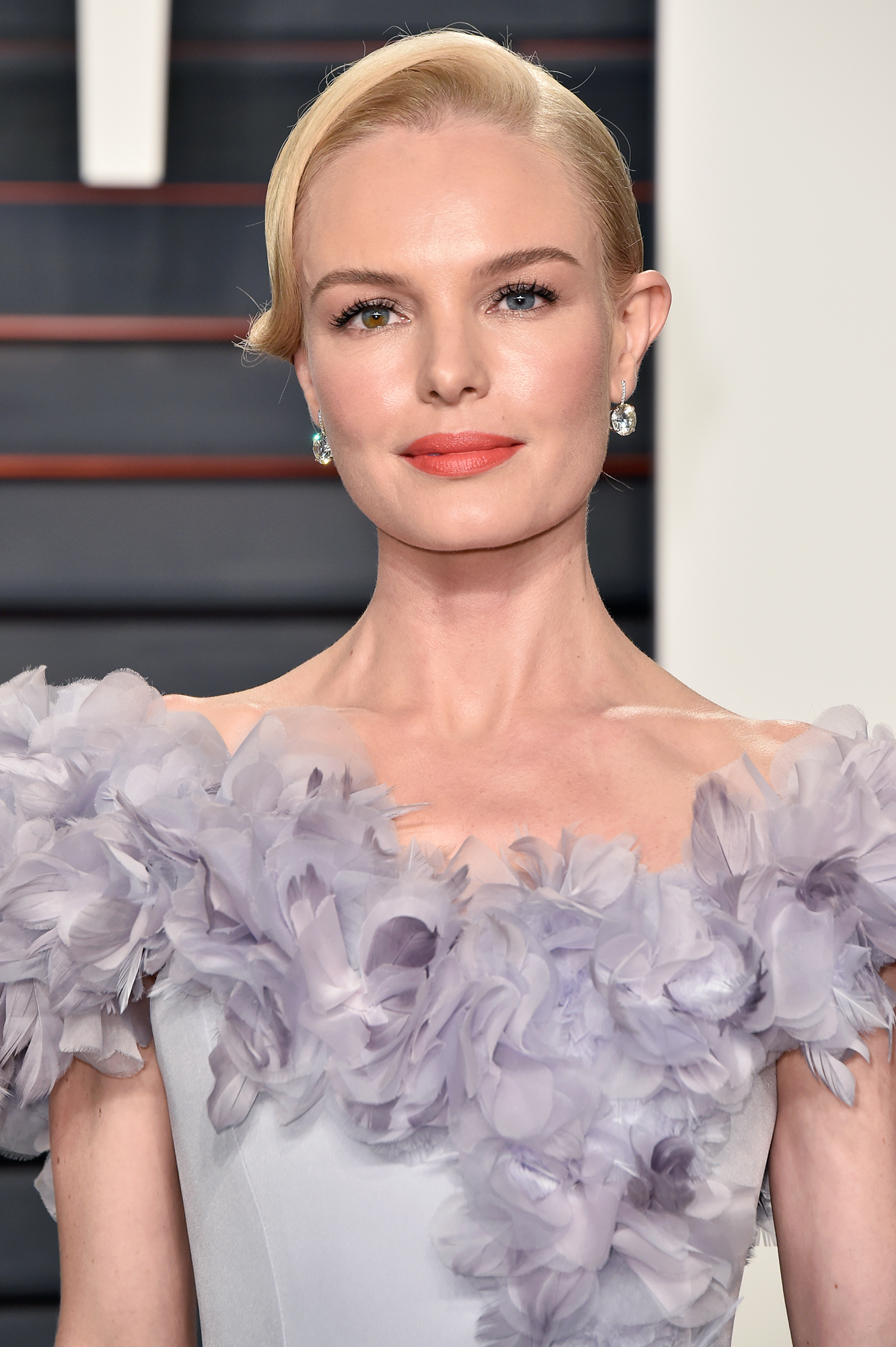 See Birthday Girl Kate Bosworth's Best Beauty Moments - True to form, Bosworth complemented her frilly Ralph & Russo gown and glam hair at the 2016 Vanity Fair Oscar Party with glowing skin and a simple peach lip.