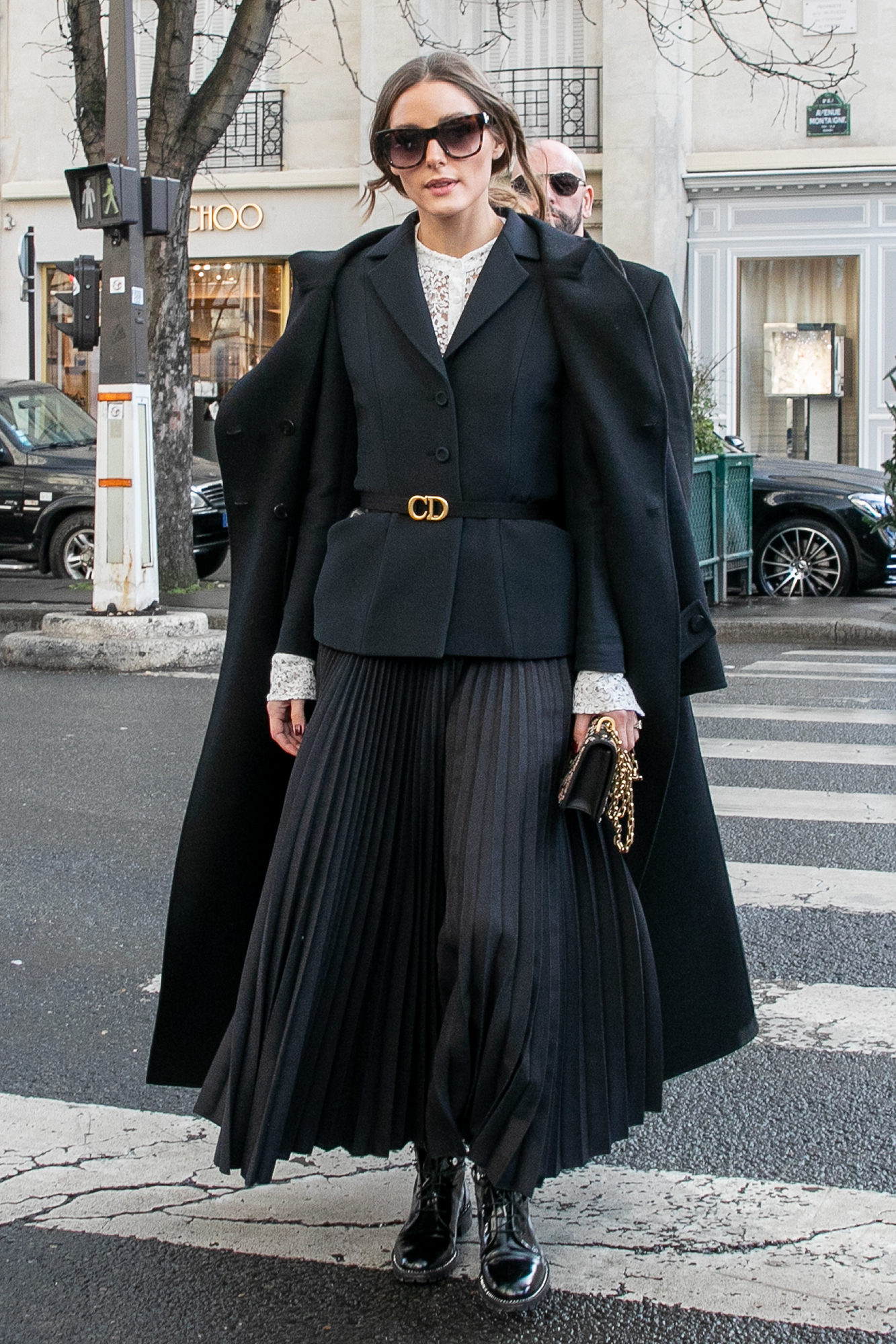 See the Best Celebrity Street Style From Paris Menswear Fall-Winter 2019 Fashion Week - The socialite showed Us how to layer up on Thursday, January 17, in her pleated skirt, lace top and blazer ensemble that she topped off with a duster coat and Dior belt.