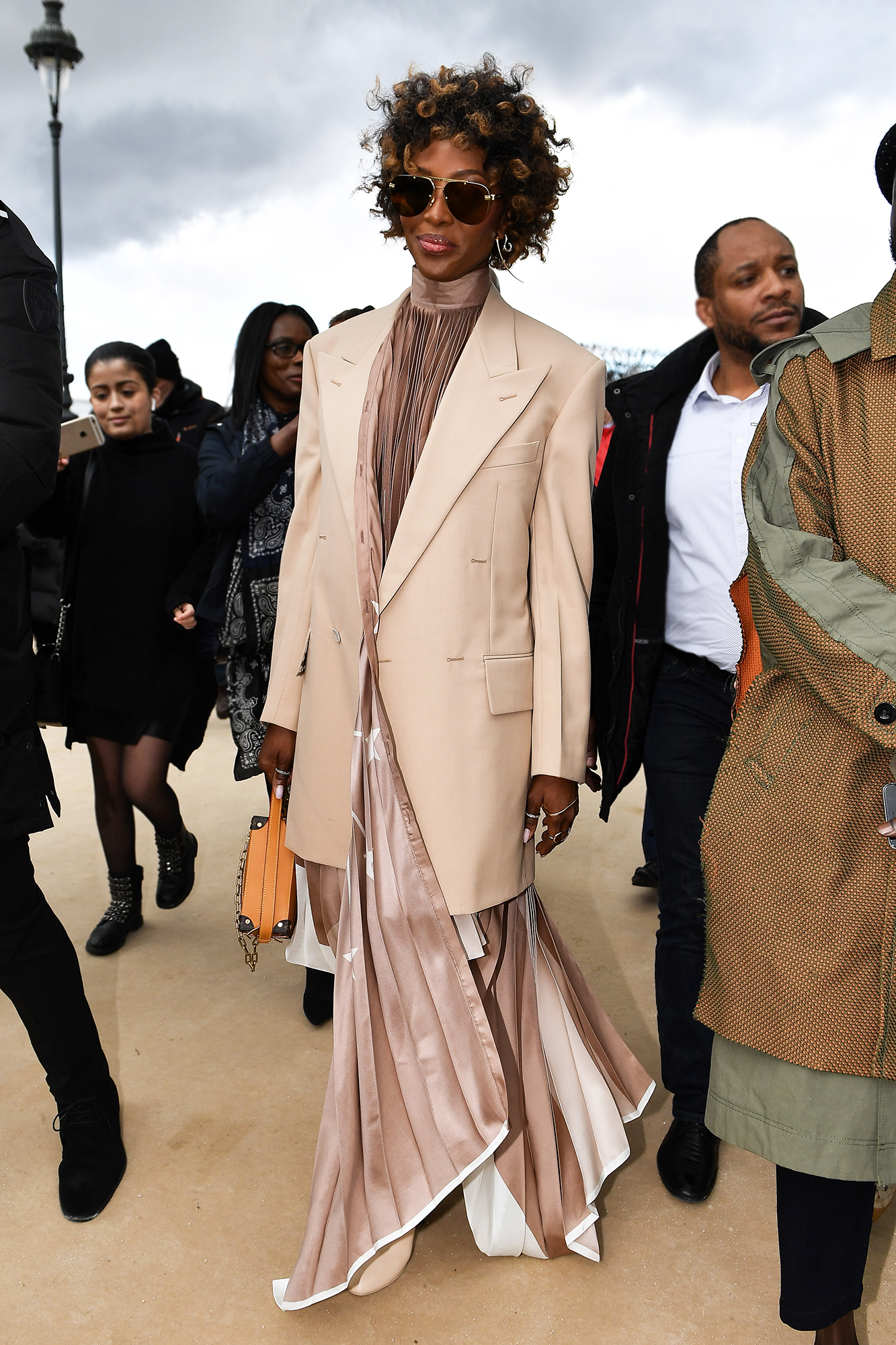 See the Best Celebrity Street Style From Paris Menswear Fall-Winter 2019 Fashion Week - Trading her signature waist-grazing locks for a cropped curly 'do, the OG supermodel stunned in neutrals at the Louis Vuitton show on Thursday, January 17.