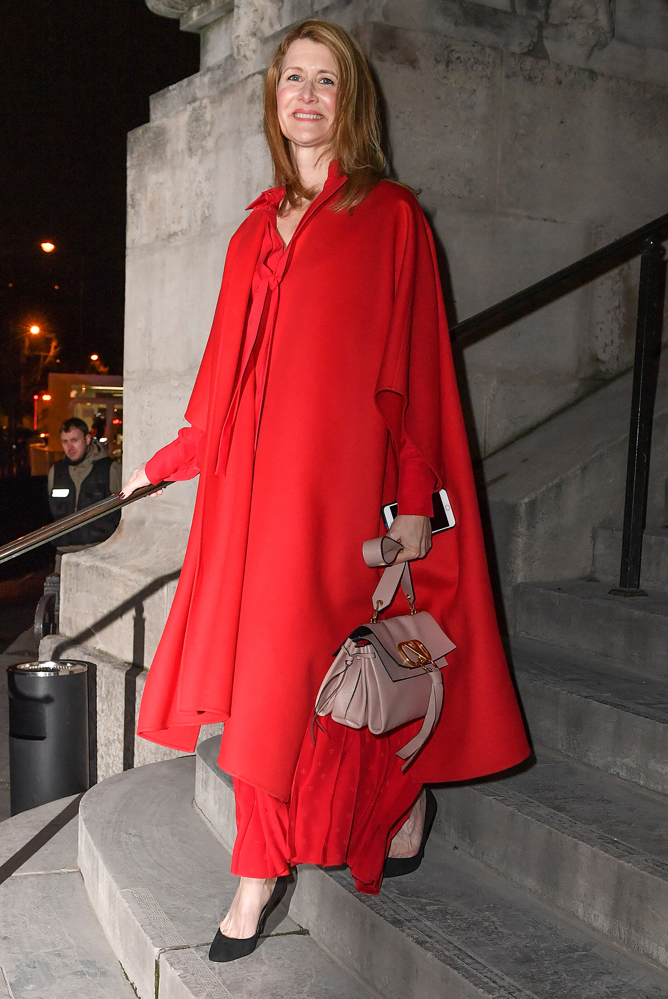 See the Best Celebrity Street Style From Paris Menswear Fall-Winter 2019 Fashion Week - Red hot! The Big Little Lies star stunned in a voluminous red ensemble at the Valentino show on Wednesday, January 16.