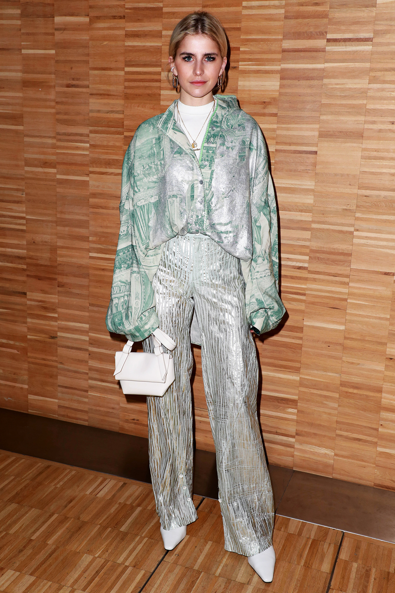 See the Best Celebrity Street Style From Paris Menswear Fall-Winter 2019 Fashion Week - The blogger shined in metallic pleated pants and a silver-accented blouse at the Acne Studio presentation on Wednesday, January 16.