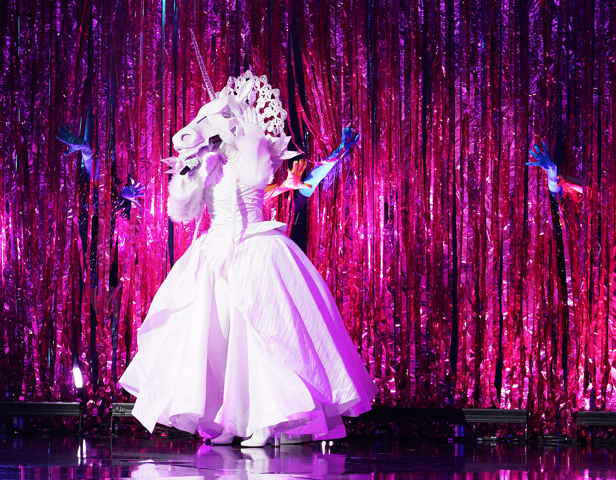 """THE-MASKED-SINGER--Unicorn - If you weren't sure if Tori Spelling was the unicorn after the Beverly Hills, 90210 clues on week one, this week confirmed it. She revealed in the new video she felt """"victorious"""" and said, """"I lost my Shanian"""" -- which was her first husband's last name."""