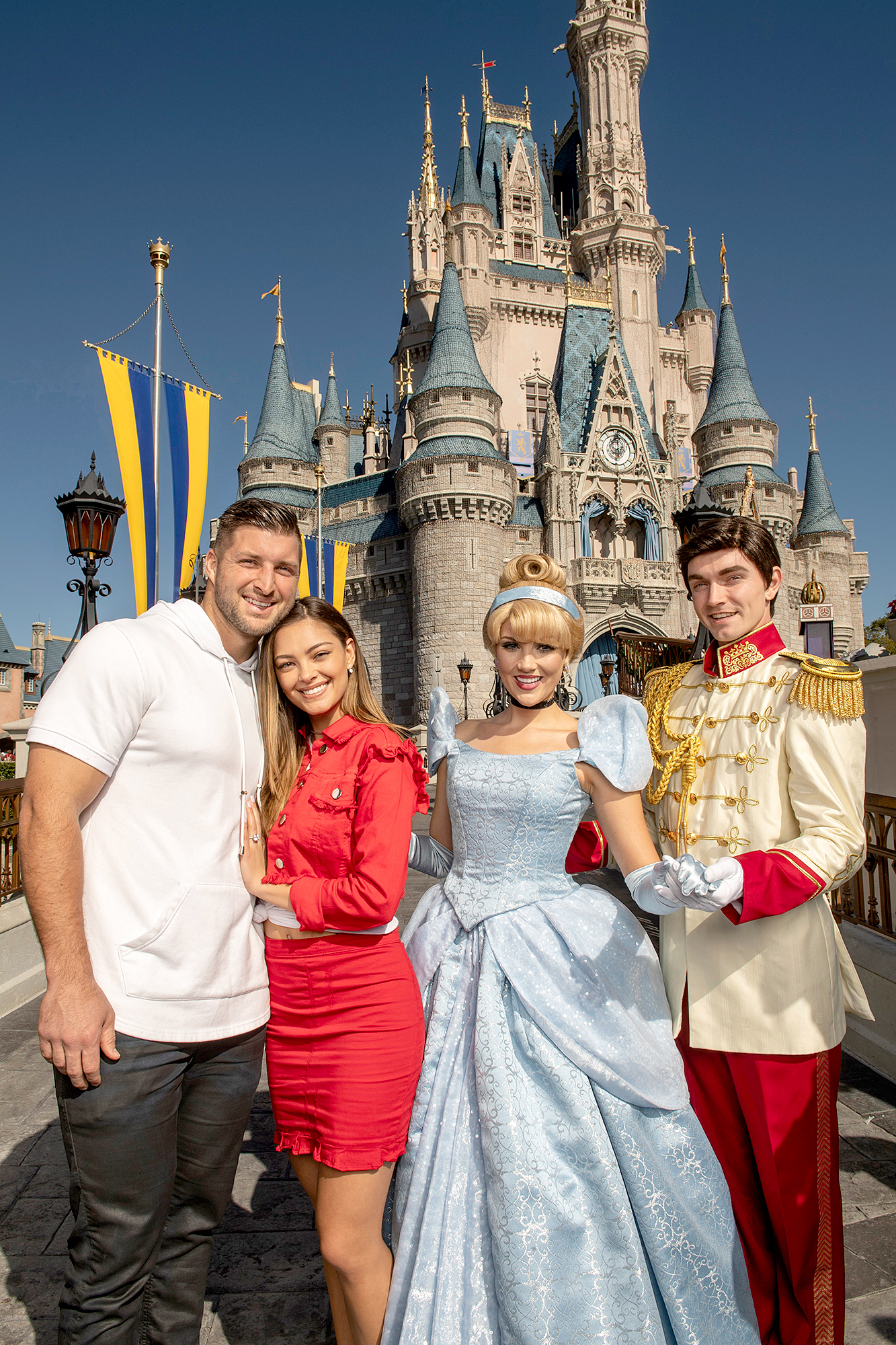 Tim-Tebow-and-Demi-Leigh-Nel-Peters-engaged-disney - The former NFL quarterback and the model posed alongside Cinderella and Prince Charming in front of the princess' castle.