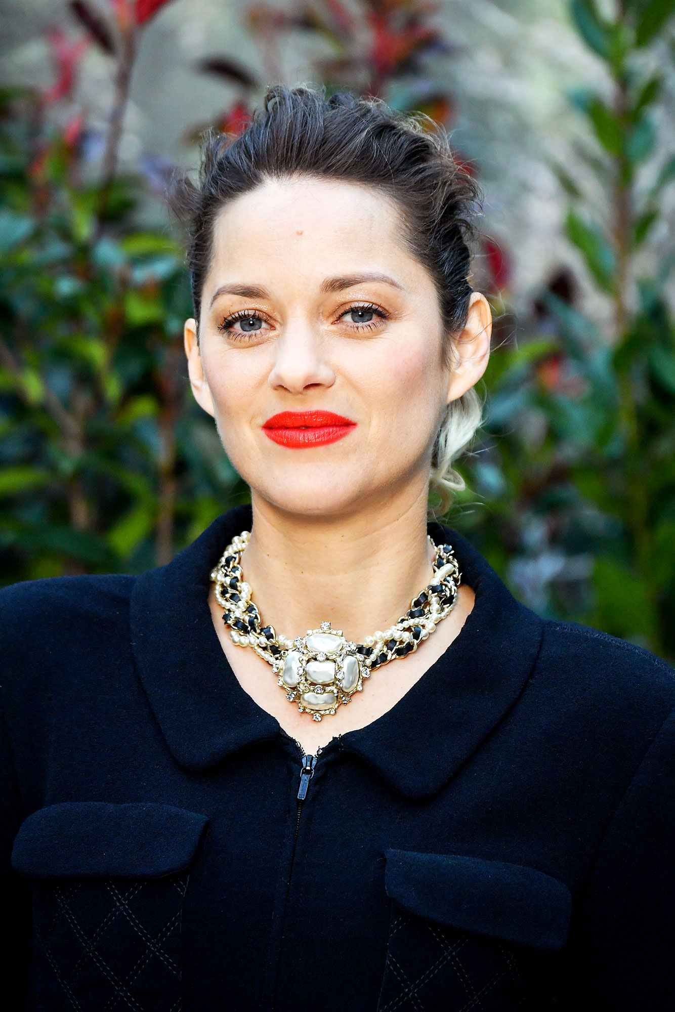 Marion Cotillard - Offering a masterclass in French-girl beauty at the Chanel Haute Couture show in Paris, the Academy Award-winner rocked glowing skin with a bright red lip that was all kinds of chic. No word on the exact shade she used, but we love the long-wear (read: kiss-proof) powers of the Chanel Rouge Allure Liquid Powder in Radical (a vibrant red-orange).