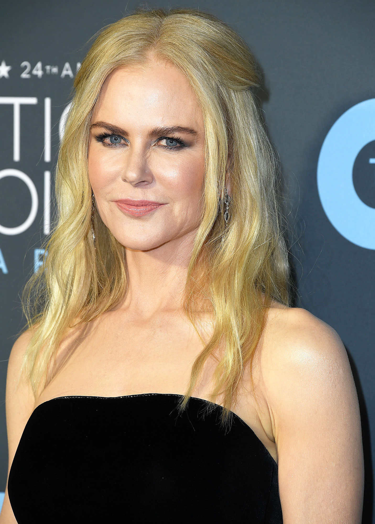Nicole Kidman - For a romantic take on the classic half-up, half-down style, hairstylist Kylee Heath left a few face-framing tendrils out of the actress' Critics' Choice Awards 'do. On Instagram, the pro shared that she used Harry Josh Pro Tools to create the loose waves and finished things off with Oribe styling products (the Dry Texturizing Spray is a forever-fave in our book).