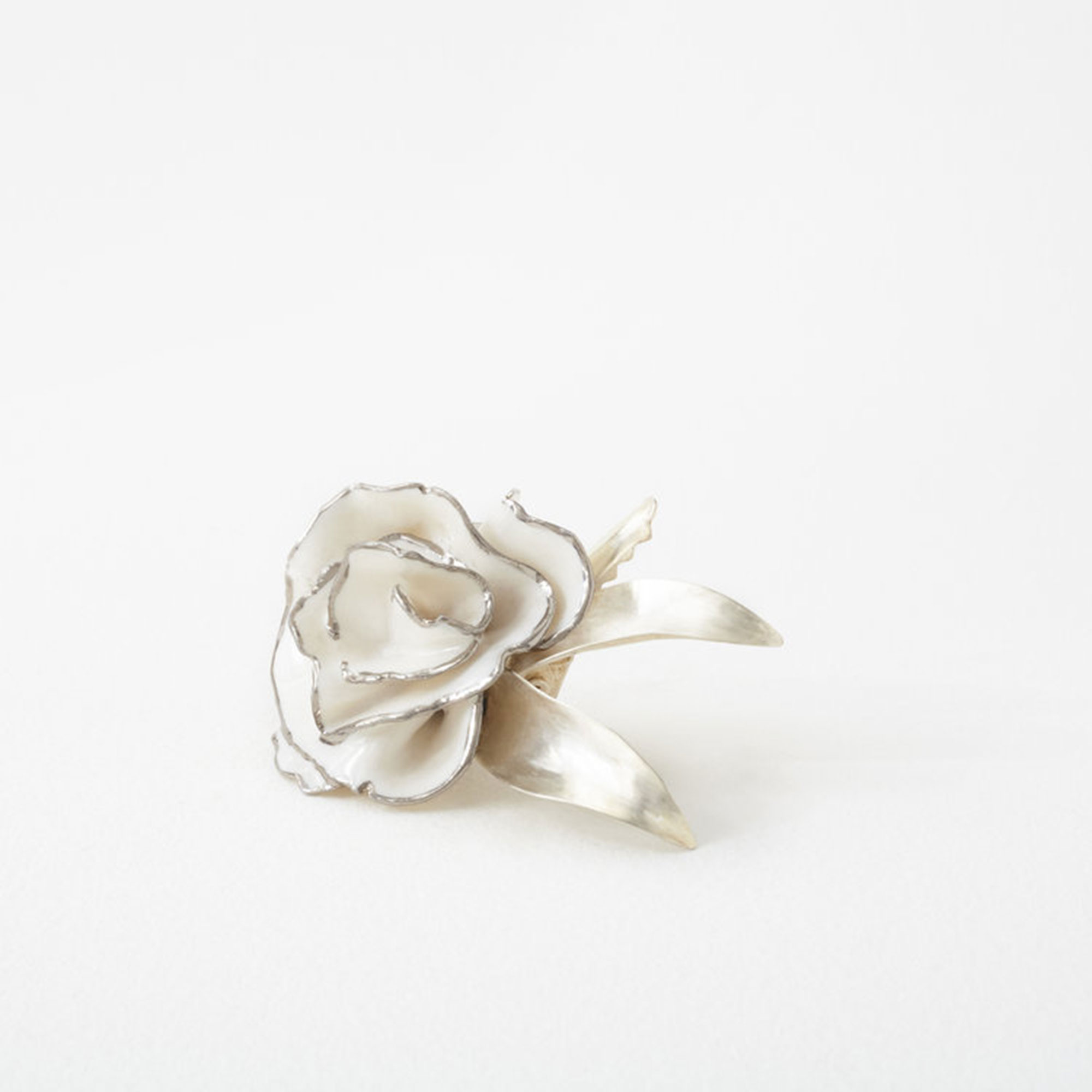 Valentine's Day Gift Guide 2019: Beauty and Fashion Ideas for the Lady in Your Life - Perfect for brides to be (or anyone leaning into the season's hair accessories trend!), these handmade floral hairpieces are truly one of a kind. $300, sweetcarolinewedding.com
