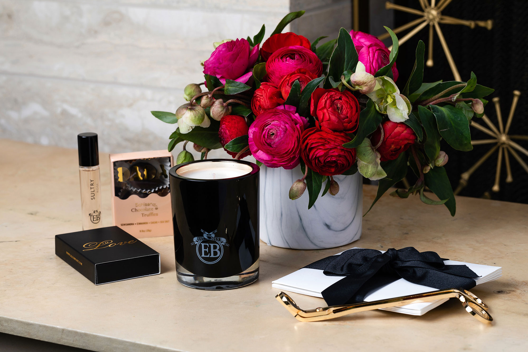 Valentine's Day Gift Guide 2019: Beauty and Fashion Ideas for the Lady in Your Life - The tried-and-true flowers and chocolate combo gets a chic upgrade courtesy of celeb florist Eric Buterbaugh's collab with the truffle connoisseurs at DADA Daily. The gift set also includes a travel-size fragrance and candle, Paddywax wick trimmer, Love DL & Co. matches and notecards.