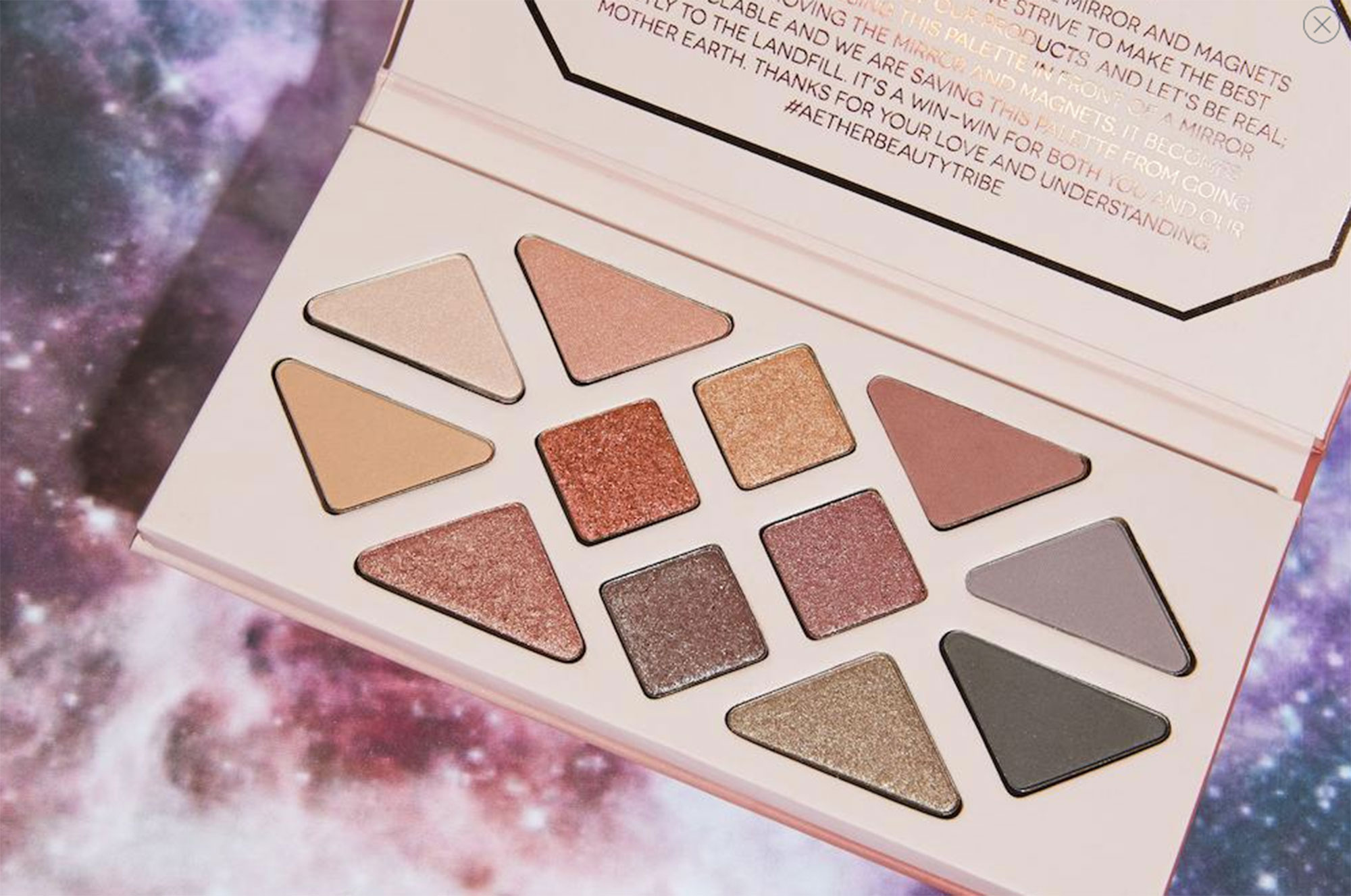 Valentine's Day Gift Guide 2019: Beauty and Fashion Ideas for the Lady in Your Life - Allow her to look good and do good with these crystal-infused eyeshadows. The matte and shimmer shades are formulated with rose quartz powder and rose hip oil to illuminate skin, and 10 percent of the palette's proceeds benefit The Water Project.