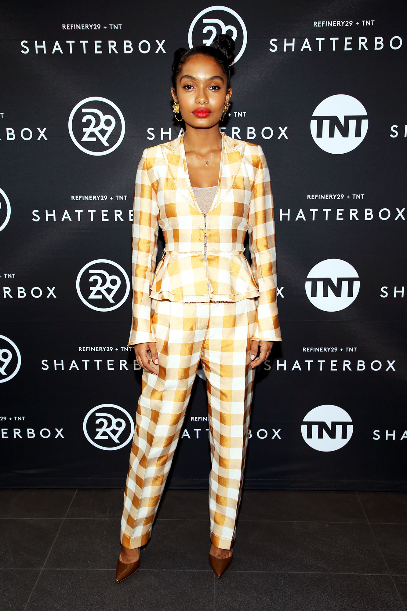 Yara Shahidi red carpet - In a Brock Collection two-piece, $42 BaubleBar earrings and Wolford bodysuit.