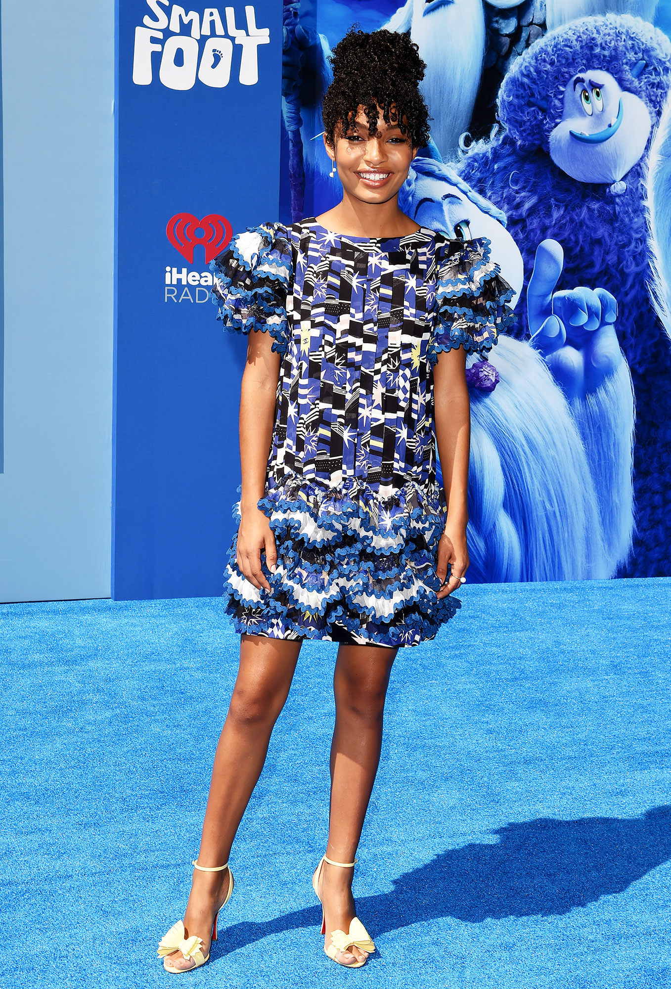 Yara Shahidi red carpet - In a $22,400 Chanel frock and $795 patent bow-detail Christian Louboutins.