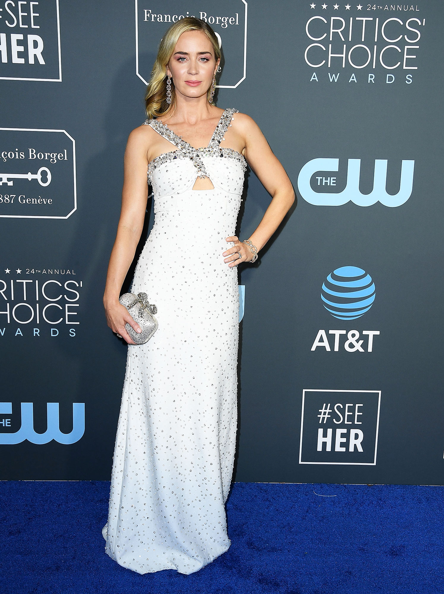 Emily Blunt arrives at the The 24th Annual Critics' Choice Awards - In a crystal Prada look with a $3,095 Jimmy Choo clutch and Lorraine Schwartz jewels.