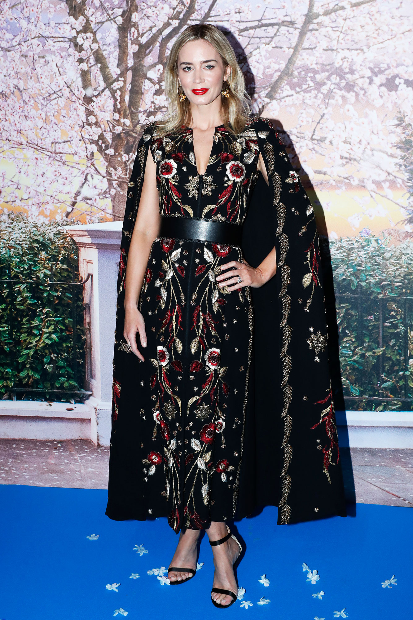 "Actress Emily Blunt attends Disney's ""Mary Poppins Returns"" - In a Zuhair Murad Couture cape dress with a leather belt and Gianvito Rossi sandals."