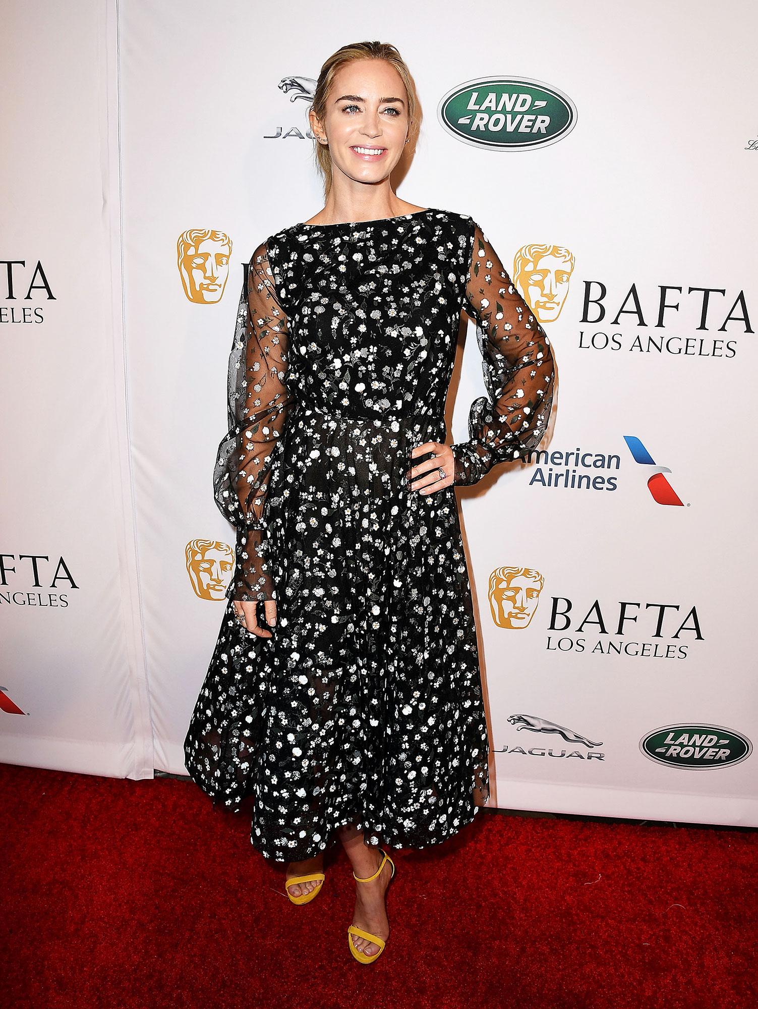 Emily Blunt arrives at The BAFTA Los Angeles Tea Party - In a $3,590 tulle Oscar de la Renta, Nancy Newberg ear cuffs and Loriblu heels.