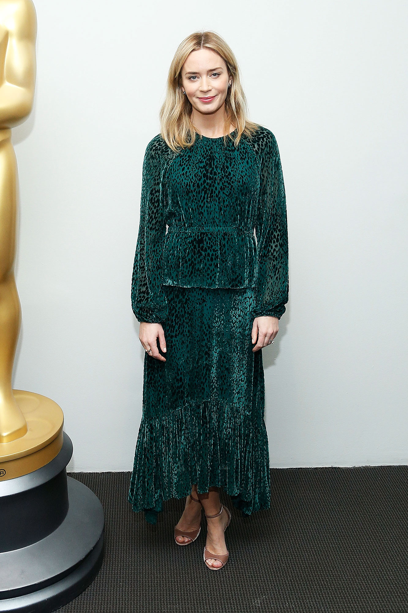 Actor Emily Blunt attends The Academy of Motion Pictures Arts and Sciences - In a $745 A.L.C. velvet leopard-print dress and $675 Jimmy Choo peep-toes.