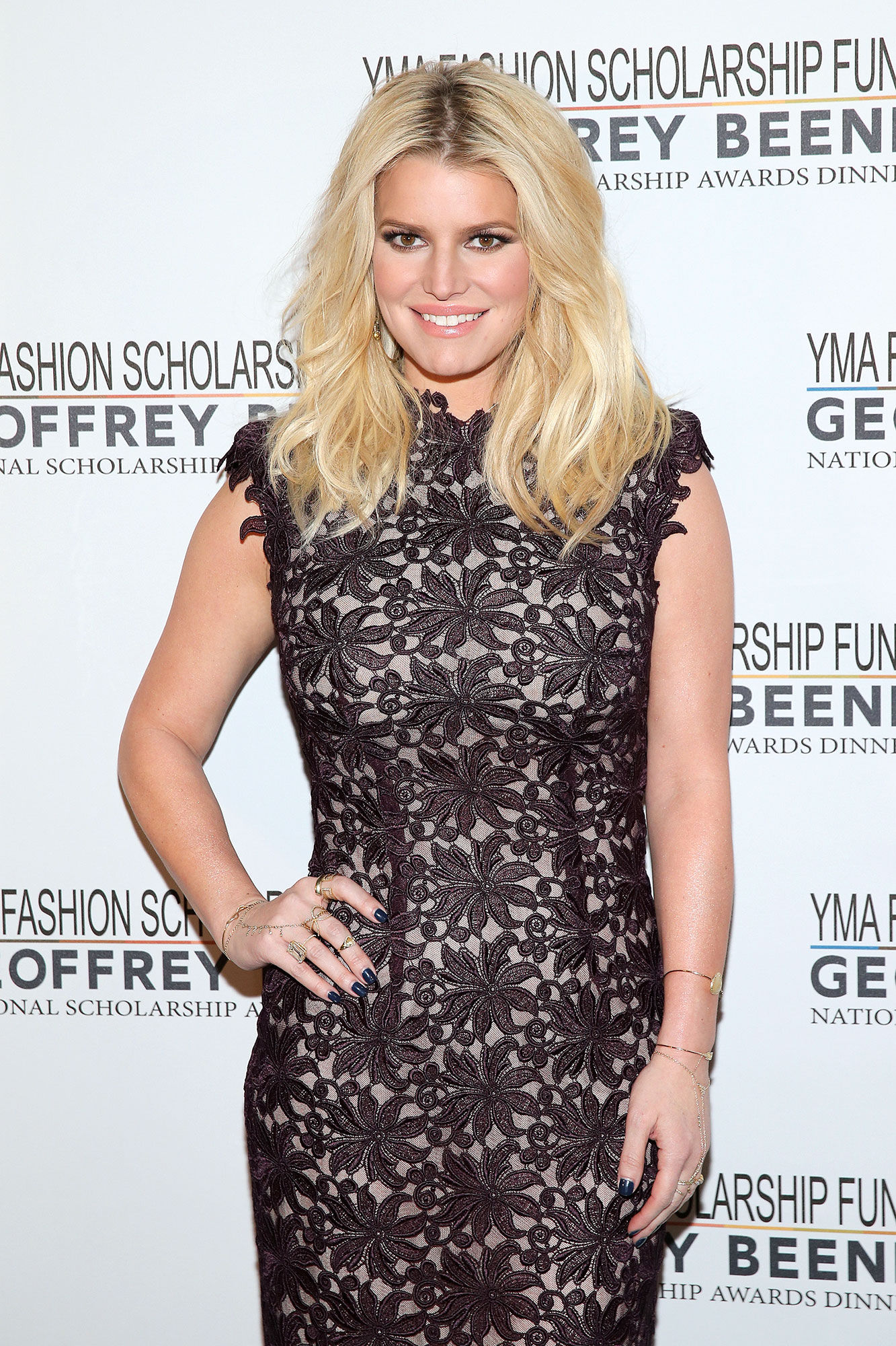 "jessica-simpson-Celebs-Who-Love-Football - Simpson was dubbed a ""jinx"" by many in December 2008 while rooting for her former man, retired Dallas Cowboys quarterback Tony Romo , from the stands in a pink jersey during the team's worst game of the season. Her ex-boyfriend John Mayer stuck up for her at the time, writing on his blog, "" That girl loves Texas more than you know . It's one of her most defining traits as a person. So please don't try and take that away from her. (You probably wouldn't be able to, but it's less work for all involved.)"" The fashion designer clearly wasn't too put off from the sport; she went on to marry former NFL tight end Eric Johnson in 2014."