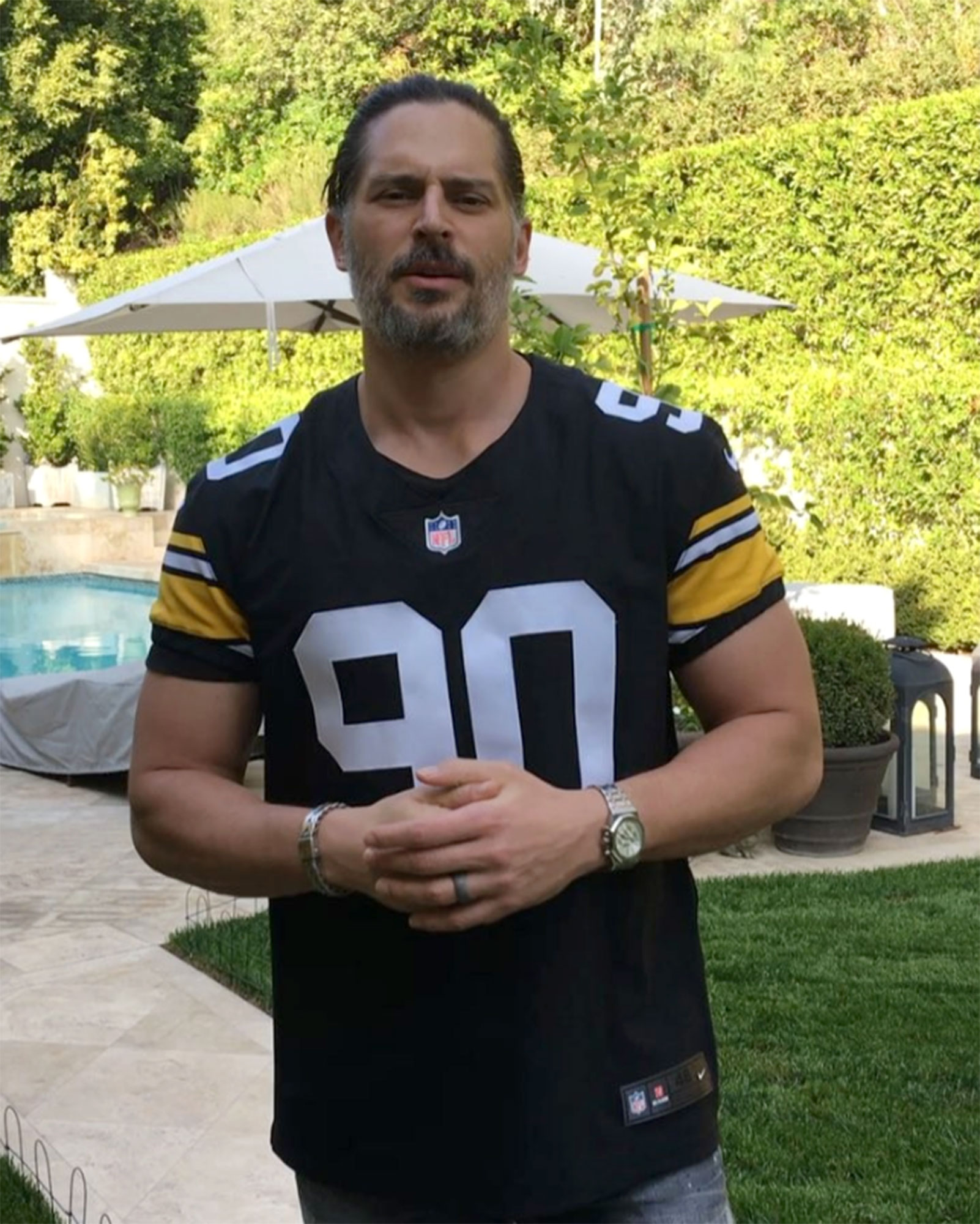 "joe-manganiello-Celebs-Who-Love-Football - The True Blood alum suited up in a throwback T.J. Watt Steelers jersey to watch the team's game against the Cleveland Browns in October 2018. ""Here we go, Steelers!"" he said in a video clip on Instagram."