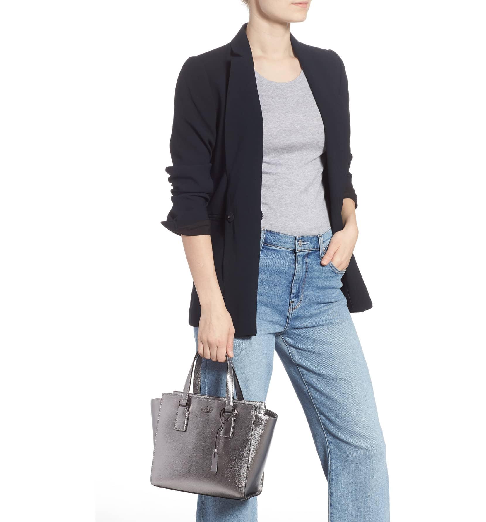 kate spade metallic leather satchel held by a model